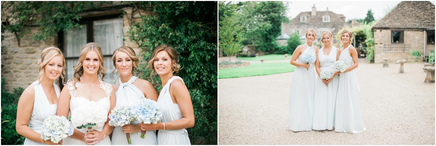 bridesmaids wearing pastel blue mismatched long dresses