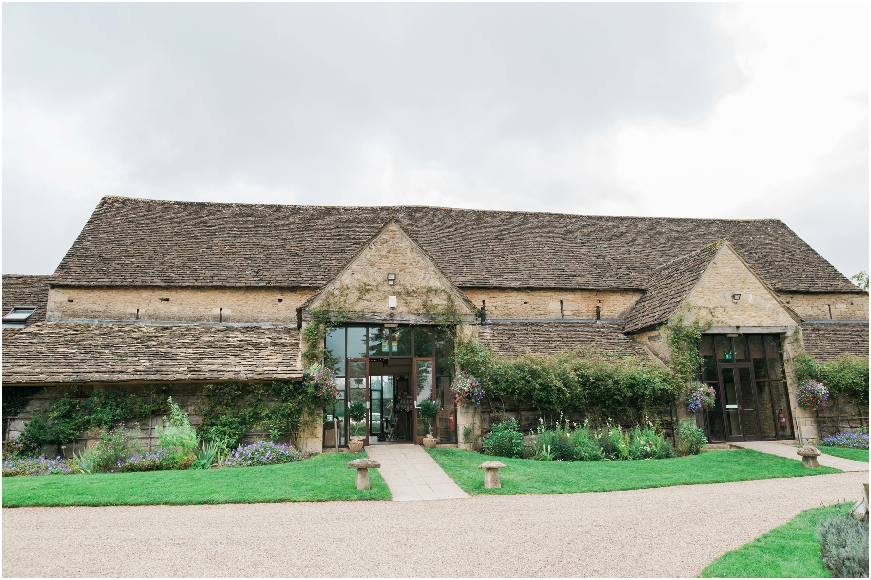 the back of the great tythe barn leading onto the gravel courtyard