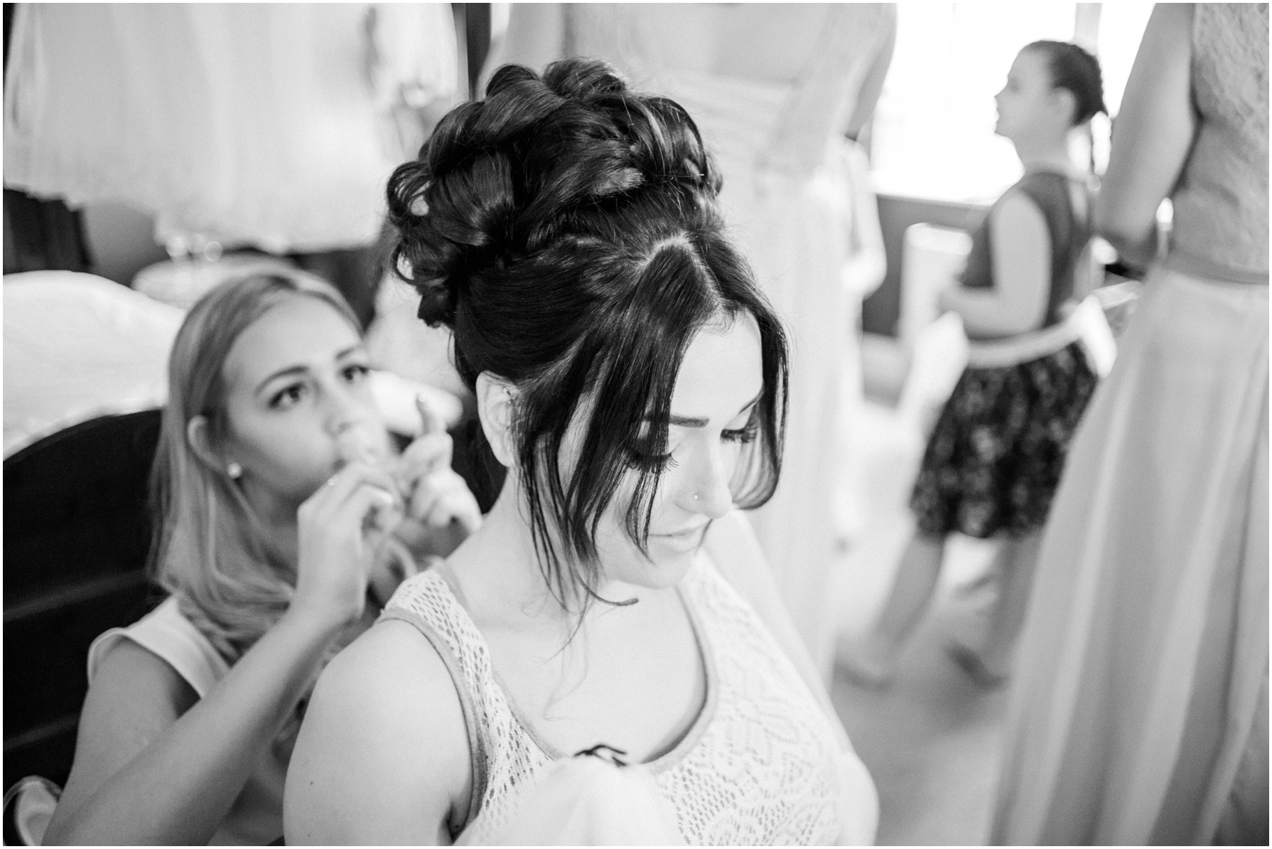 bride having her long hair put up into curls for her wedding day
