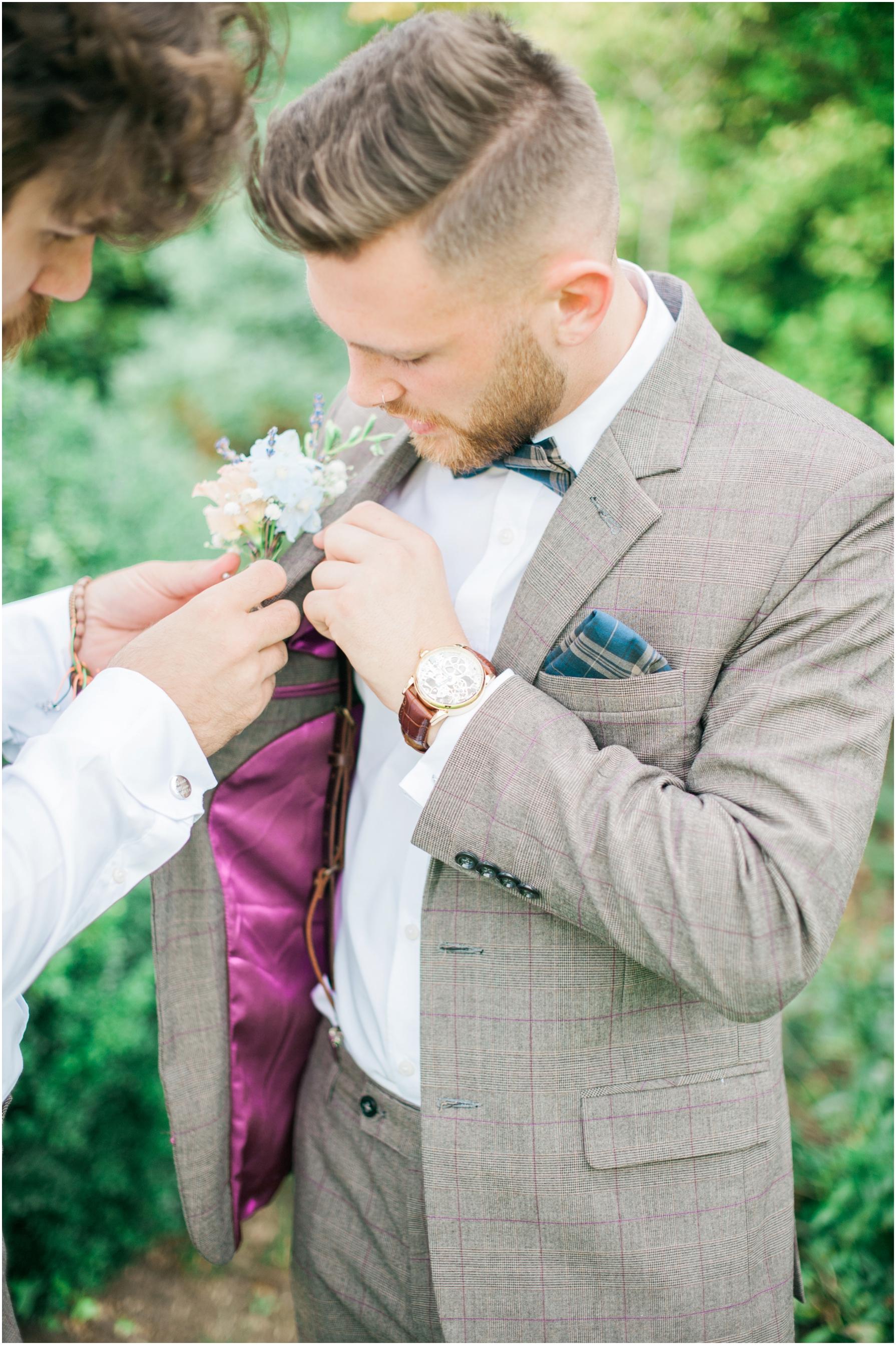 groom wearing braces and a brown tweed jacket