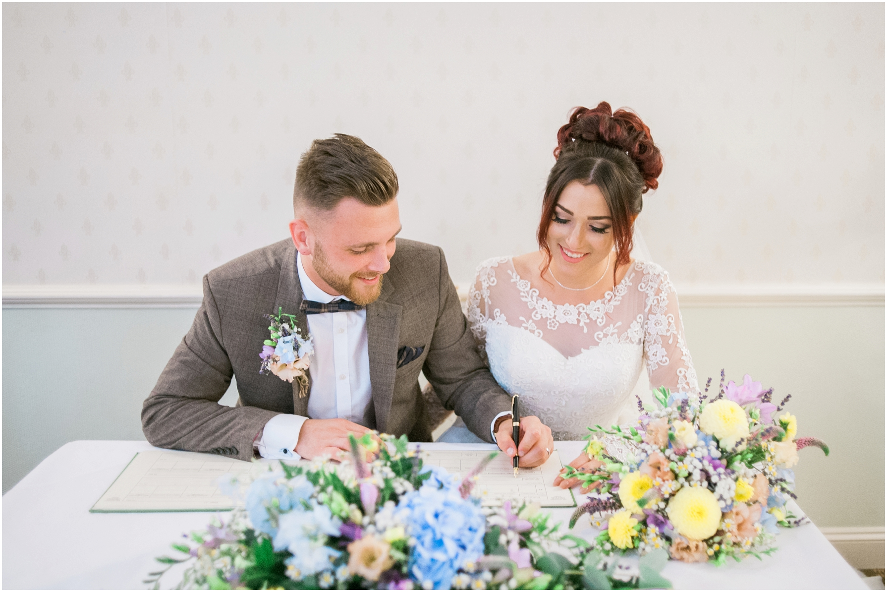 bride and groom signing the register at stratton house hotel