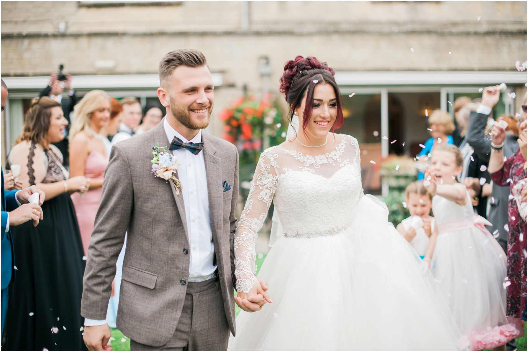 guests throwing confetti over the bride and groom at stratton house hotel