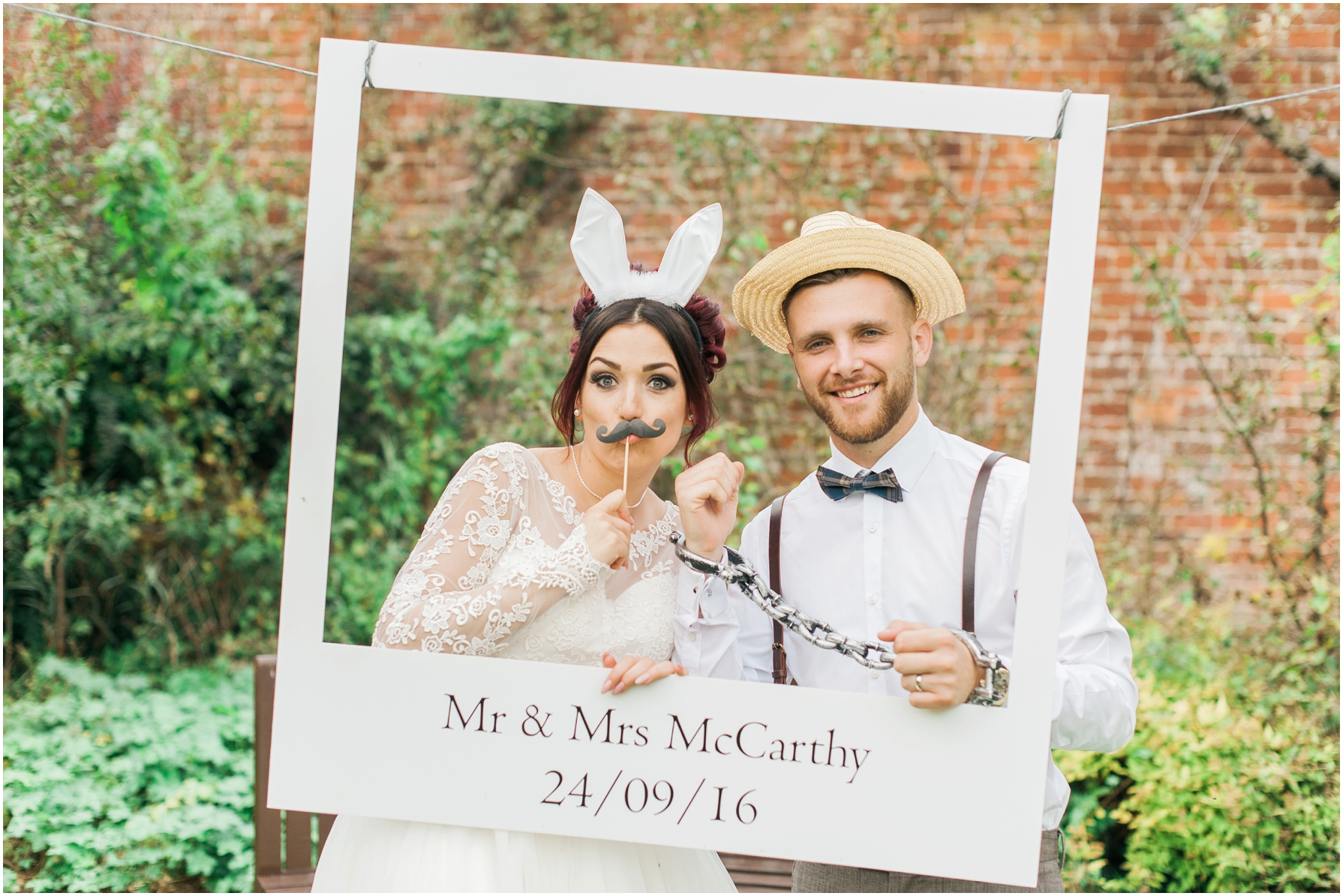 bride and groom play with vintage props in the garden at stratton house hotel