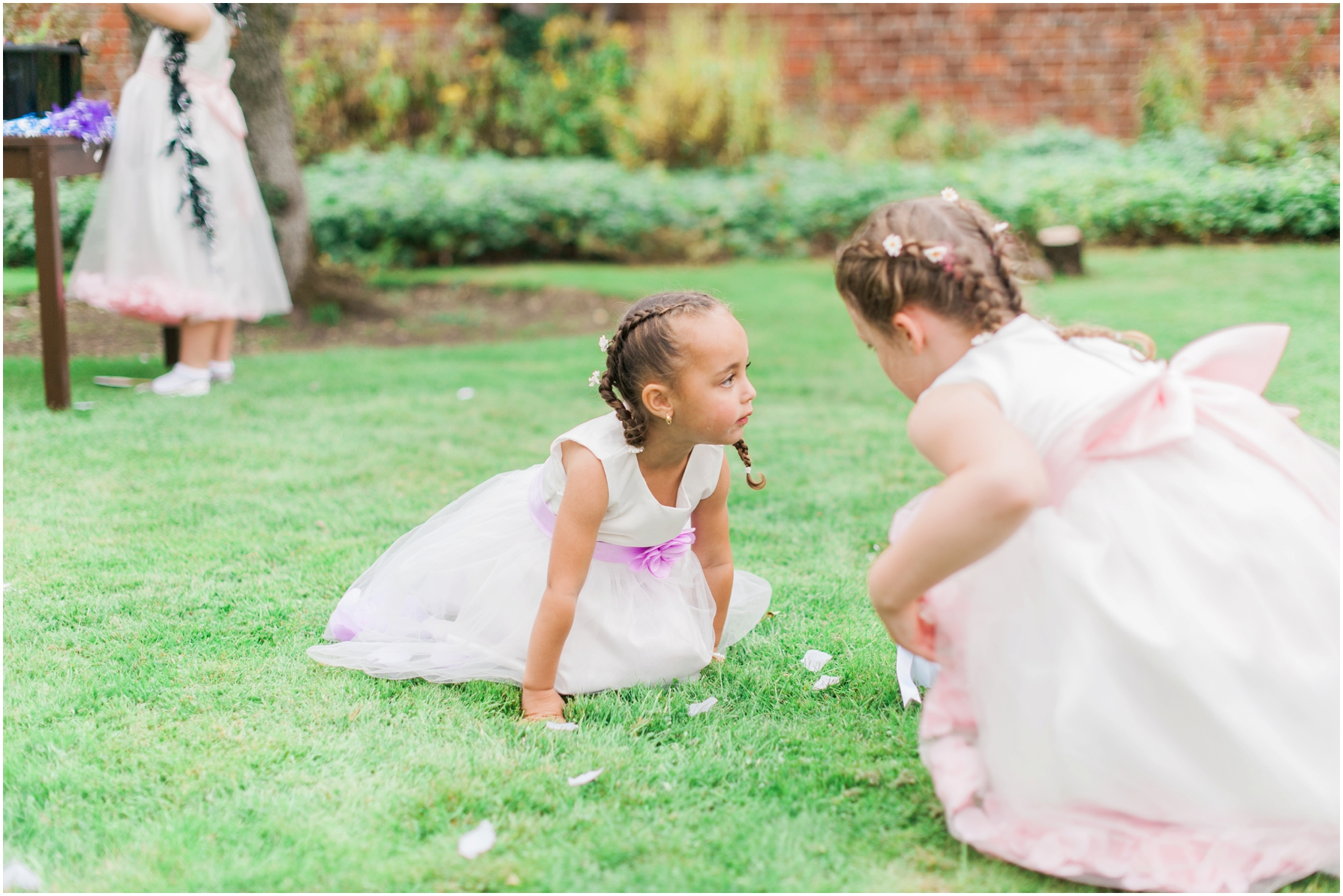 flower girls playing in the garden at stratton house hotel