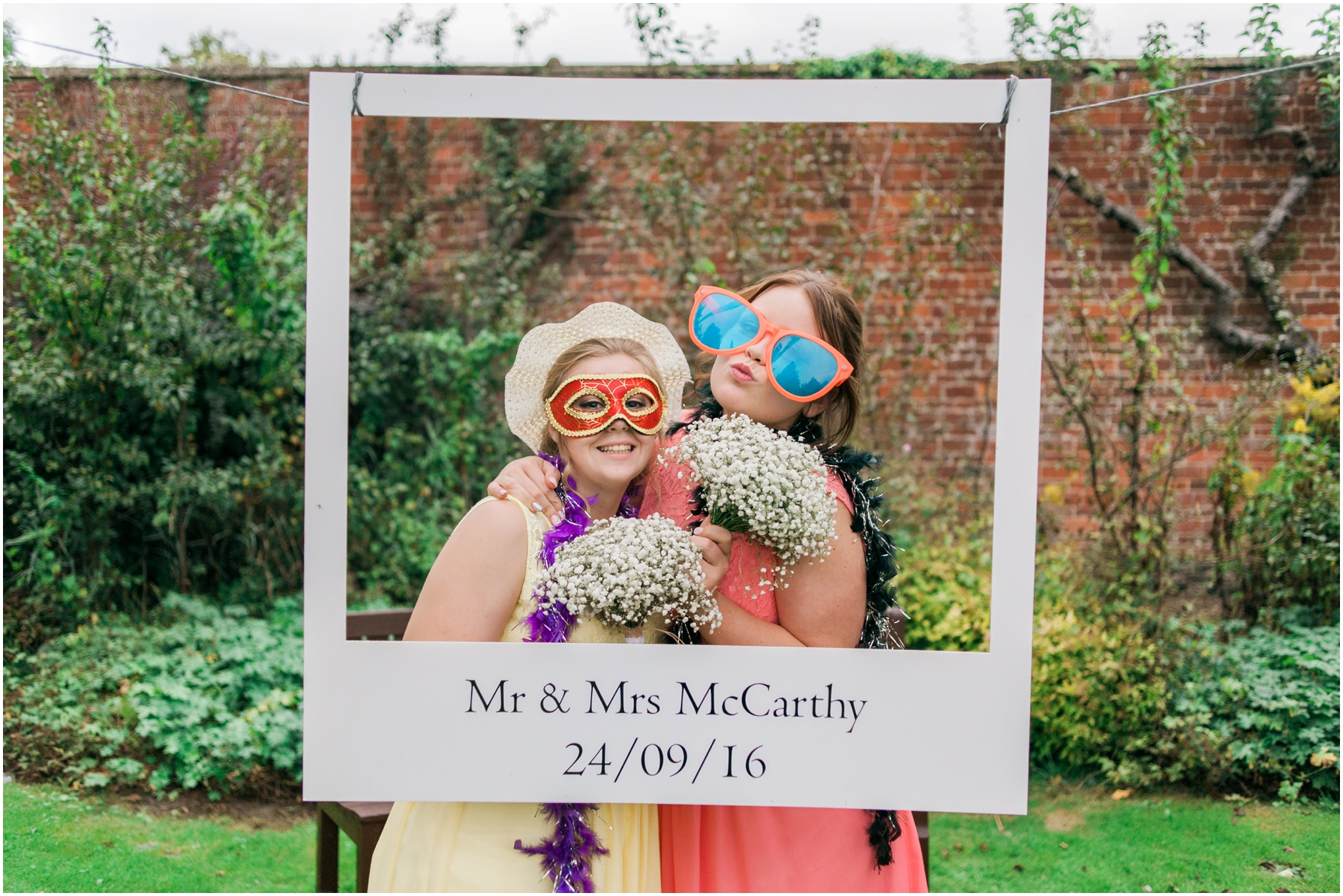 wedding guests posing outside with vintage props