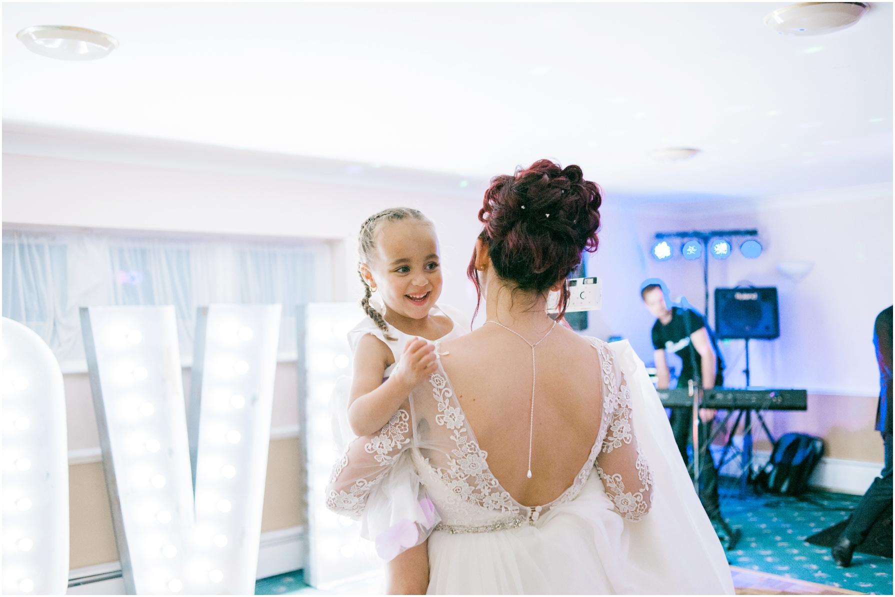 bride wearing a low back vintage wedding dress