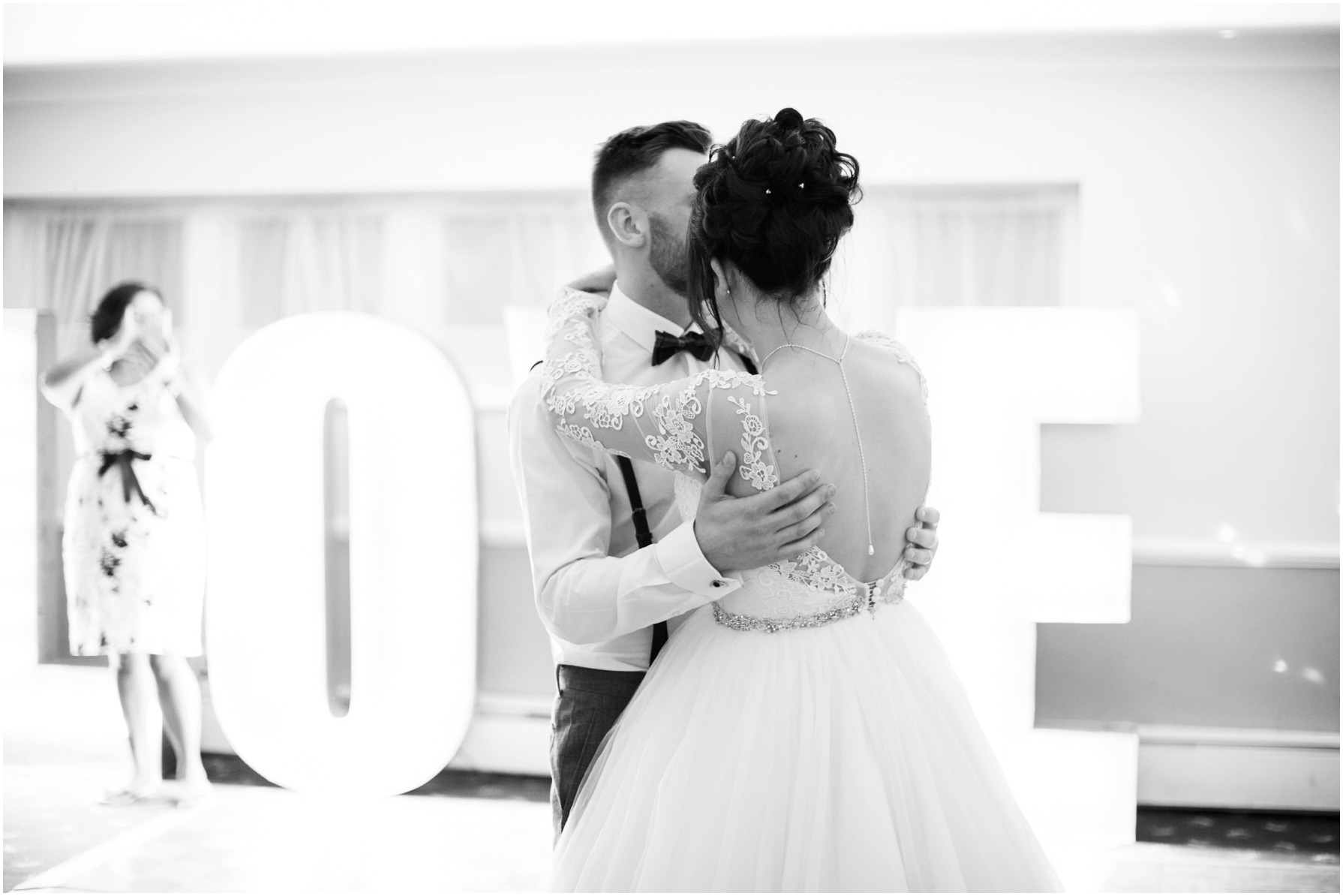 bride and groom dance to their first dance at stratton house hotel