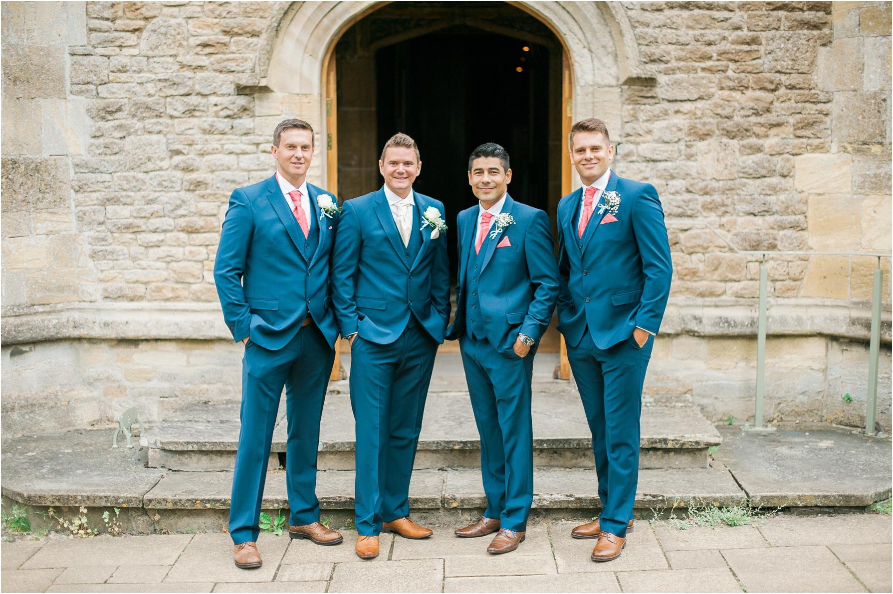 groomsmen waiting outside the church