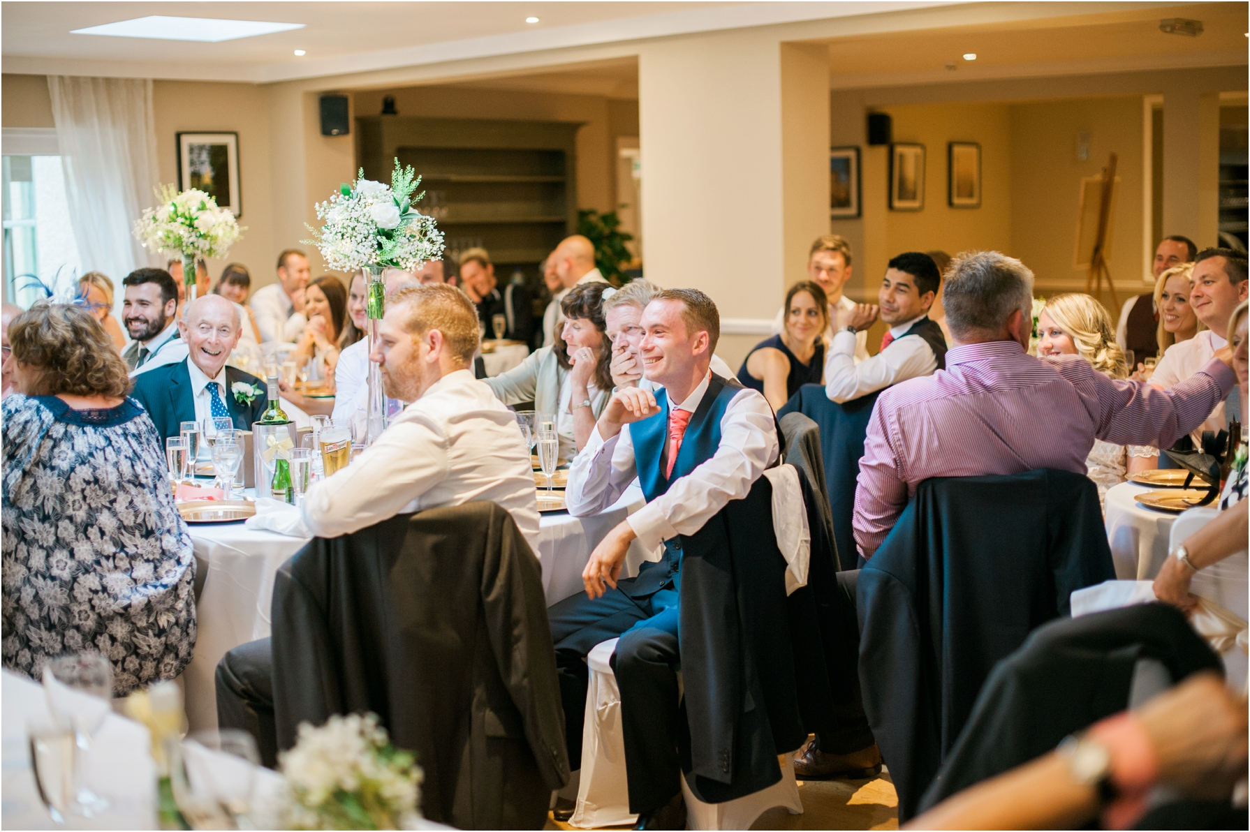 guests listening to the wedding speeches