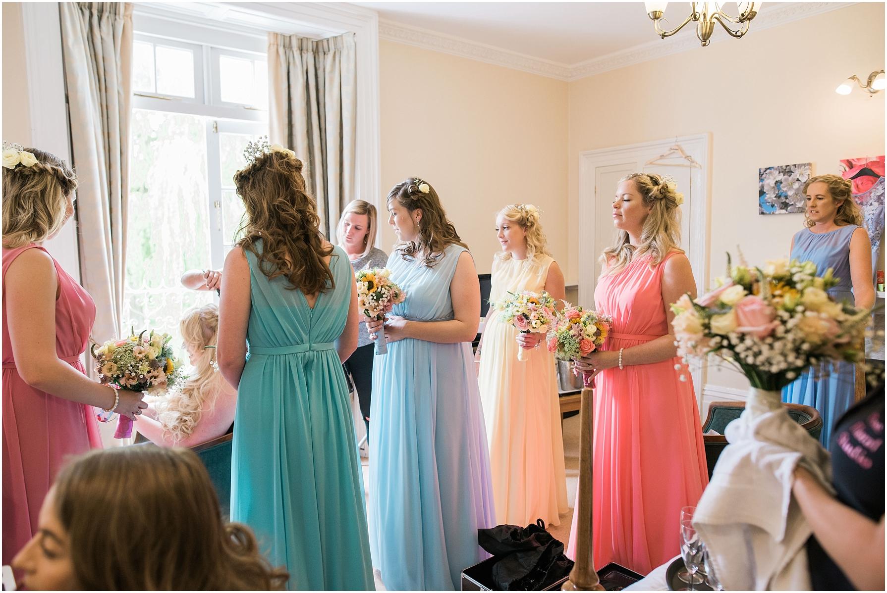 bridesmaids wearing pastel dresses at chiseldon house hotel