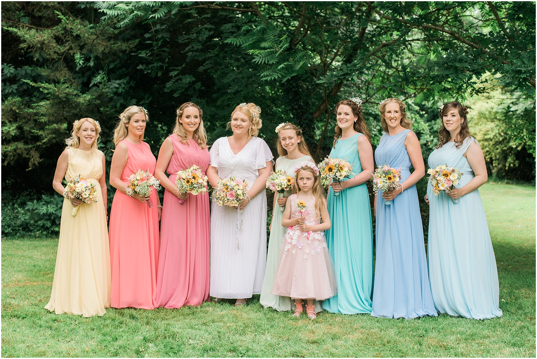 formal group shot of bride and her bridesmaids