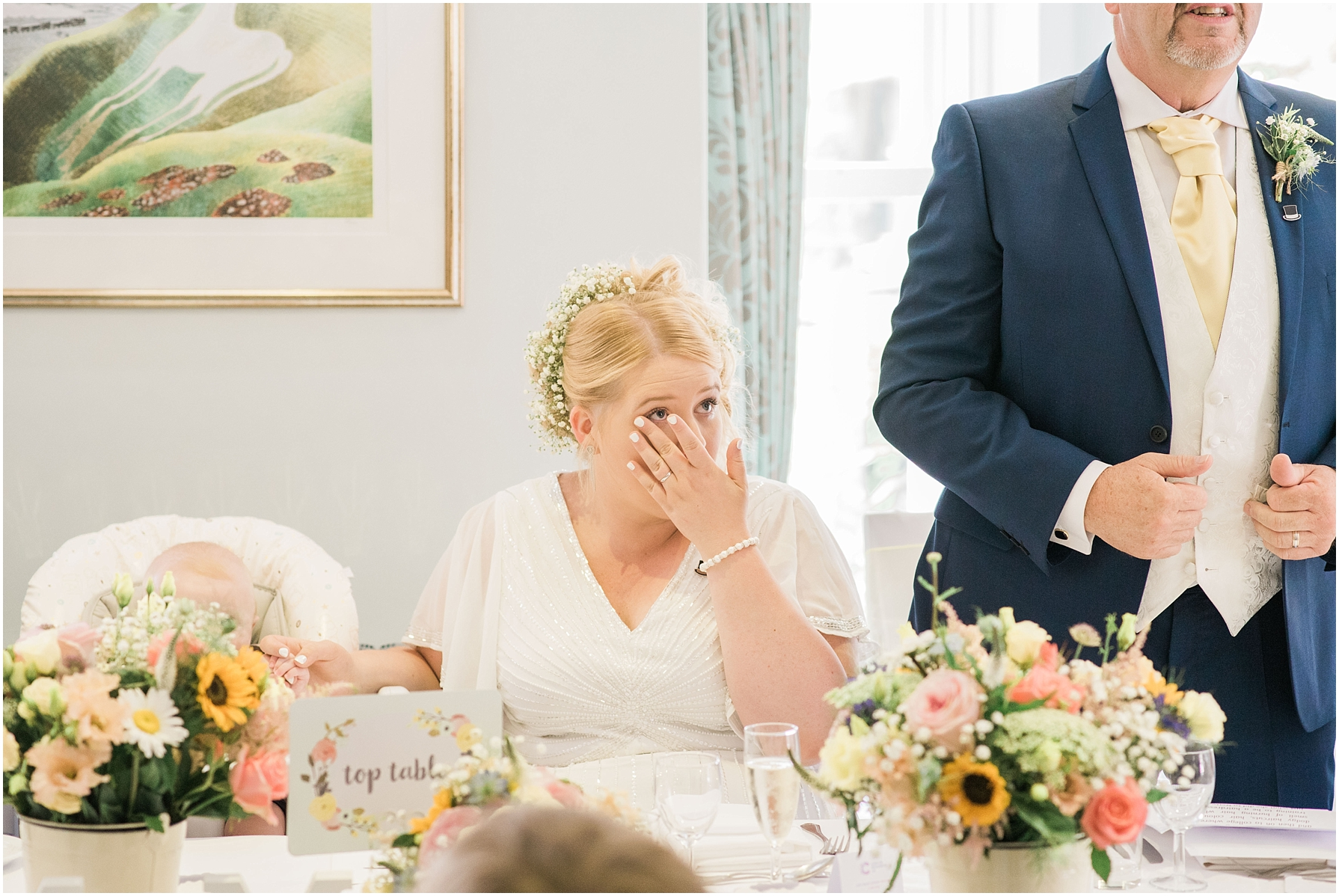 bride wiping away tears during speeches