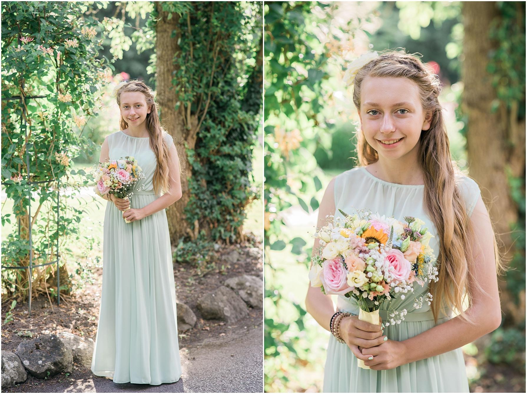 young bridesmaid wearing pastel green long dress