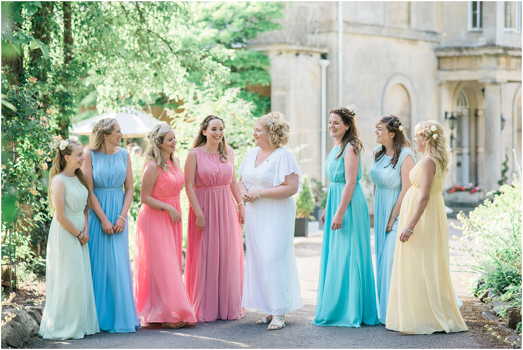 bride and her bridal party standing outside the chiseldon house hotel