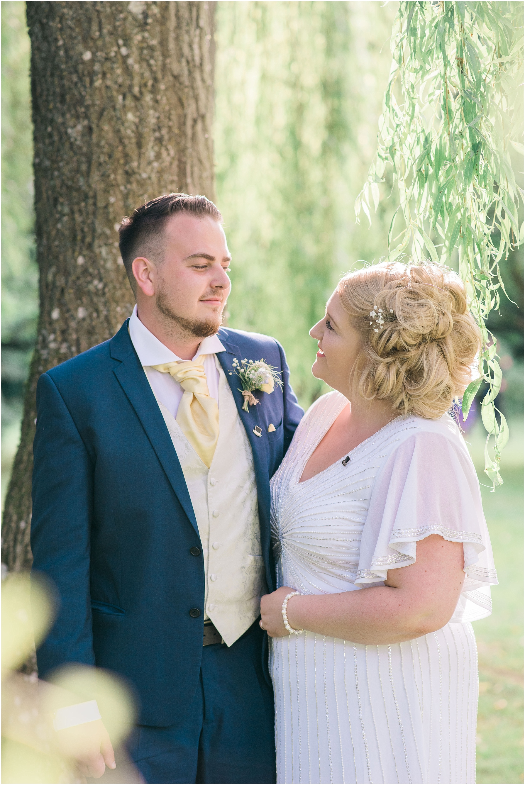 couple portraits under the willow tree at chiseldon house hotel