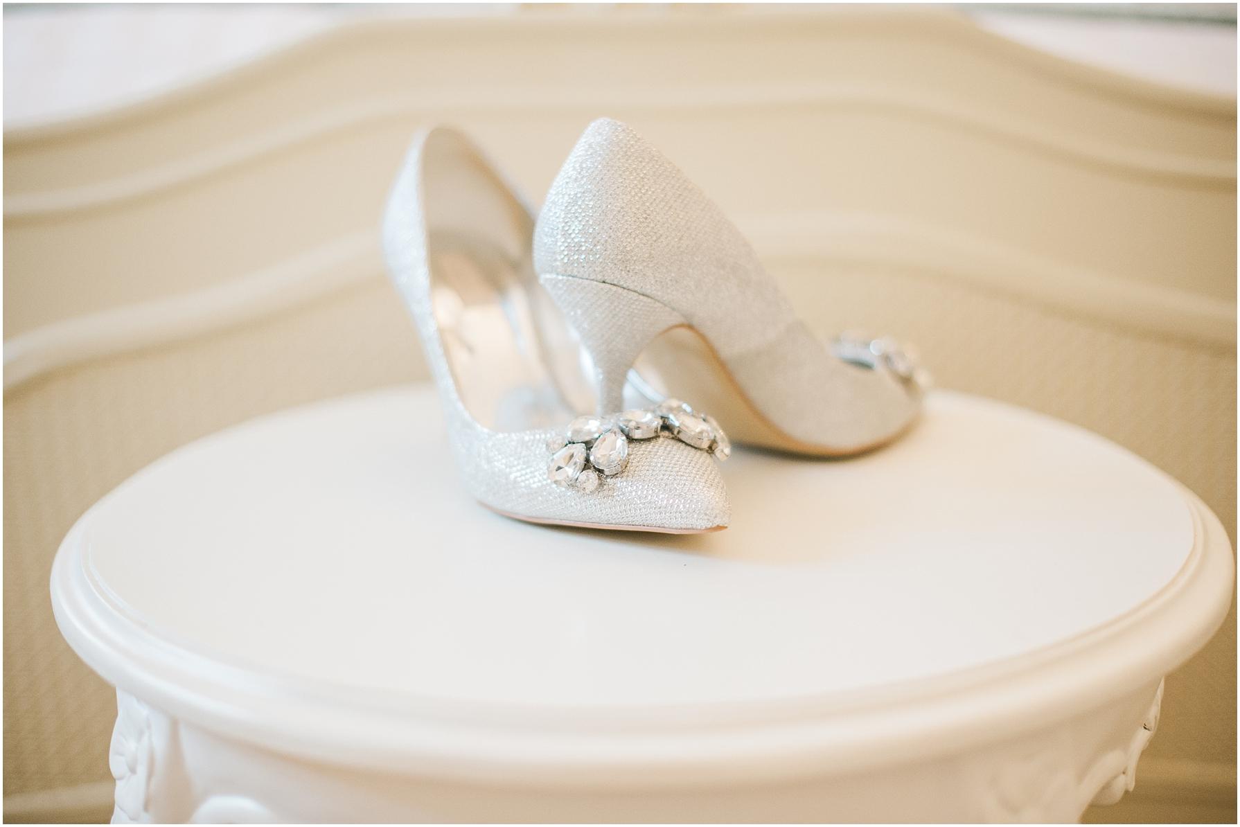 diamond wedding shoes on a white table