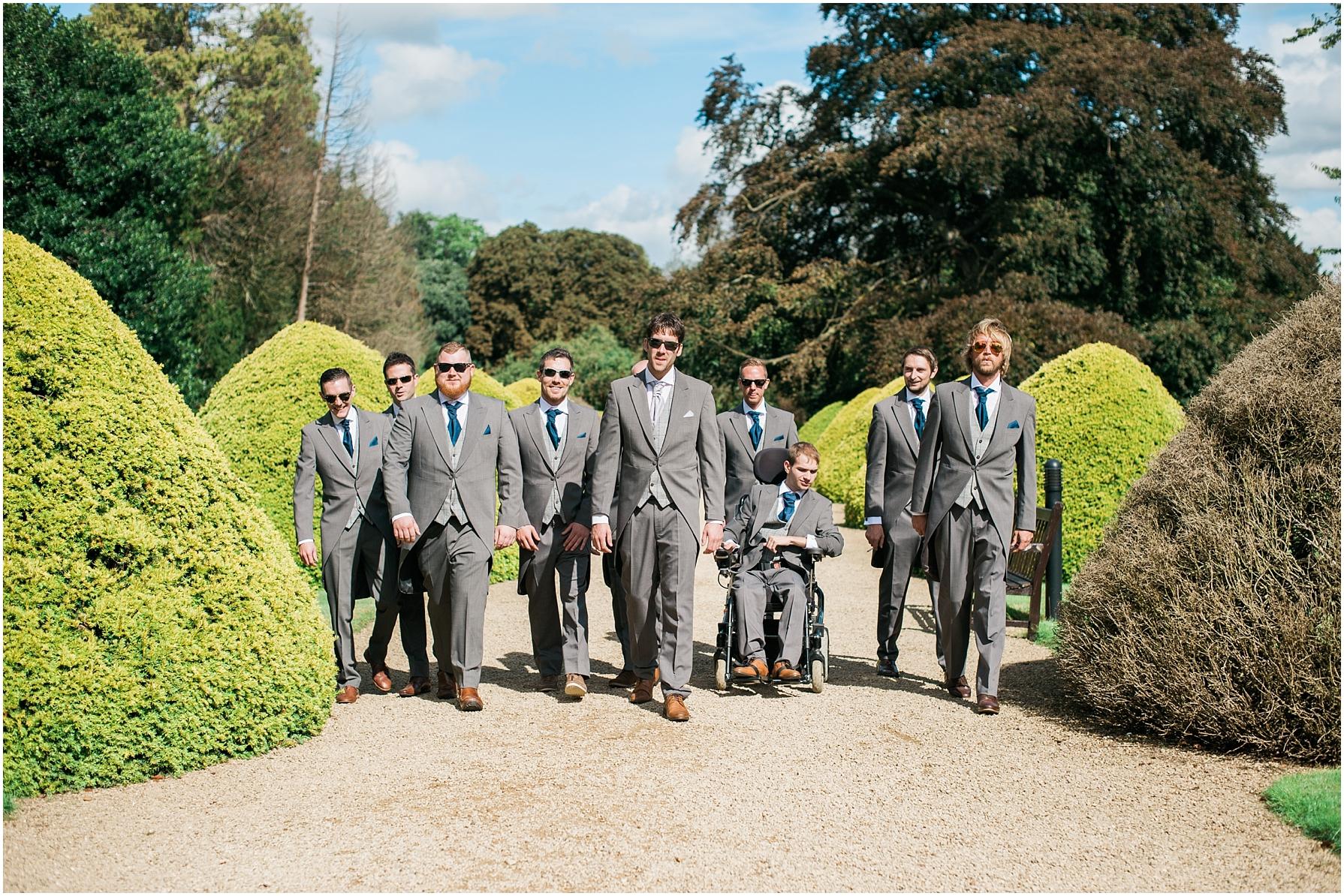 groom and groomsmen walking side by side