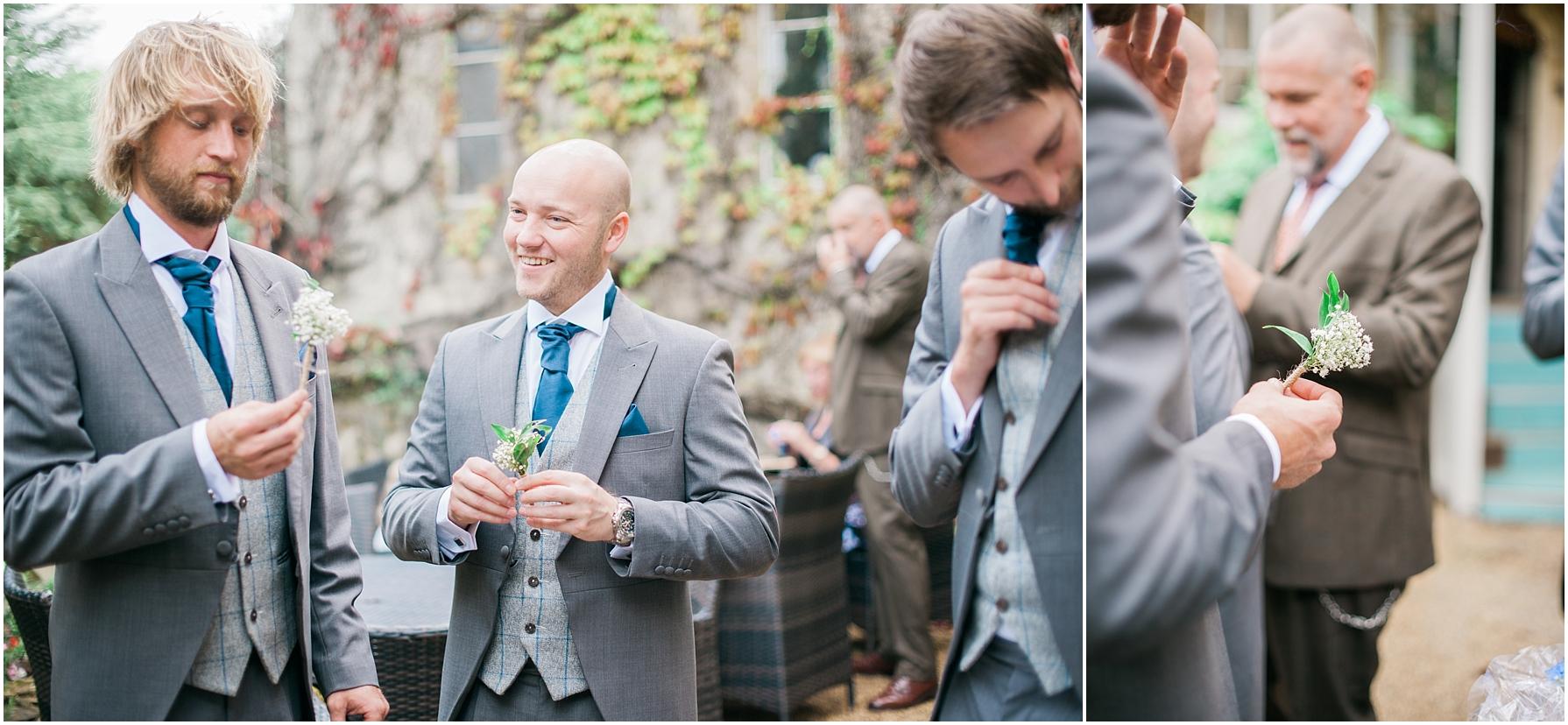 groomsmen putting on button holes
