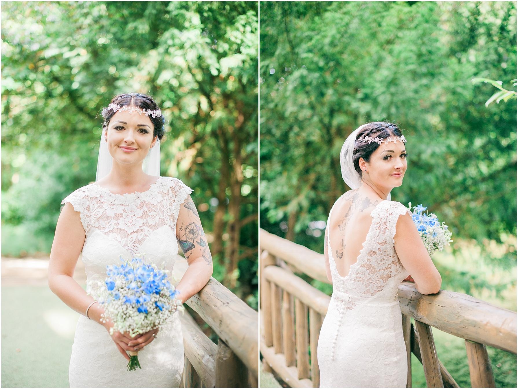 bride holding her bouquet standing on a little bridge