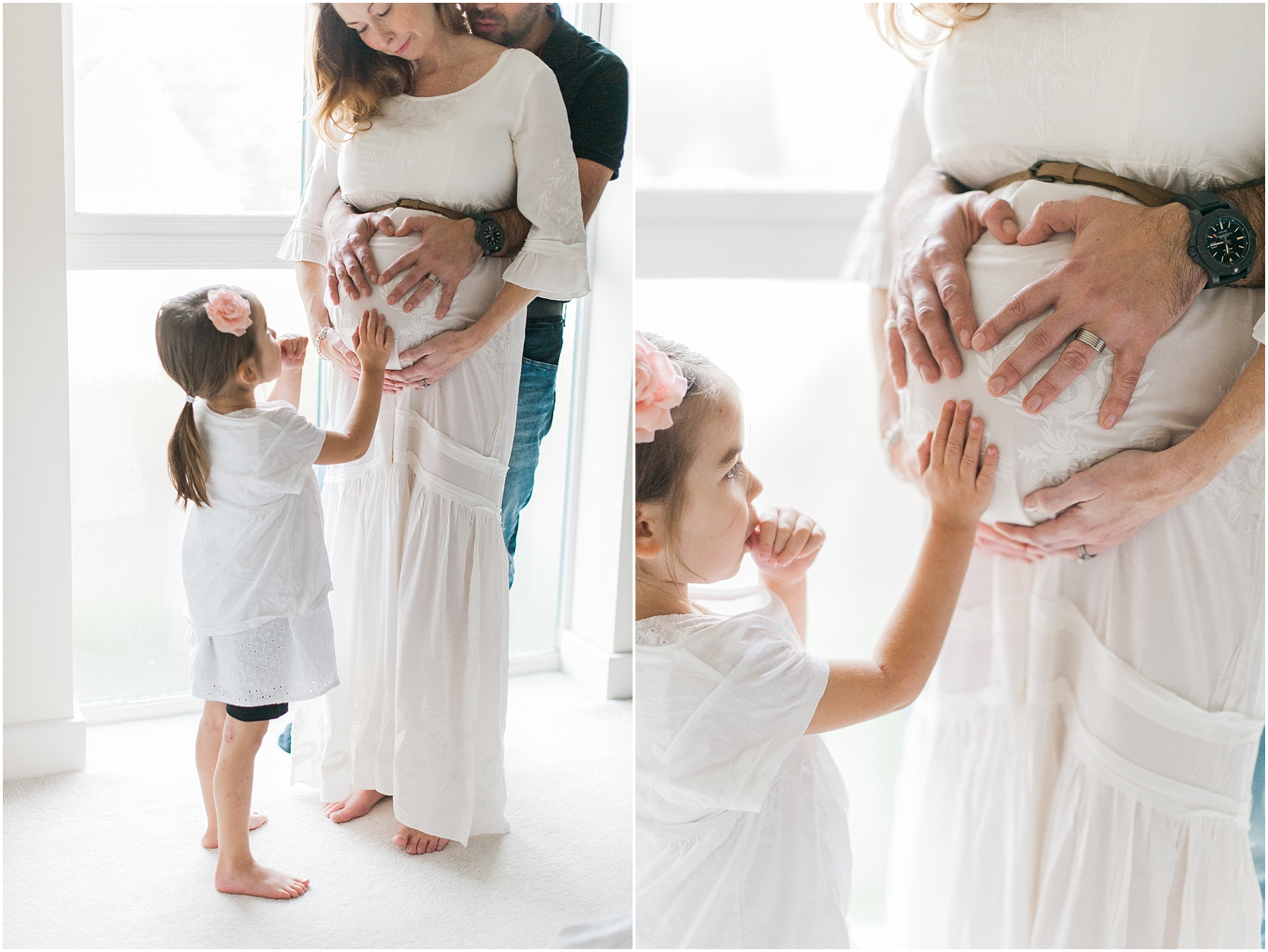 little girl touching her mothers pregnant tummy