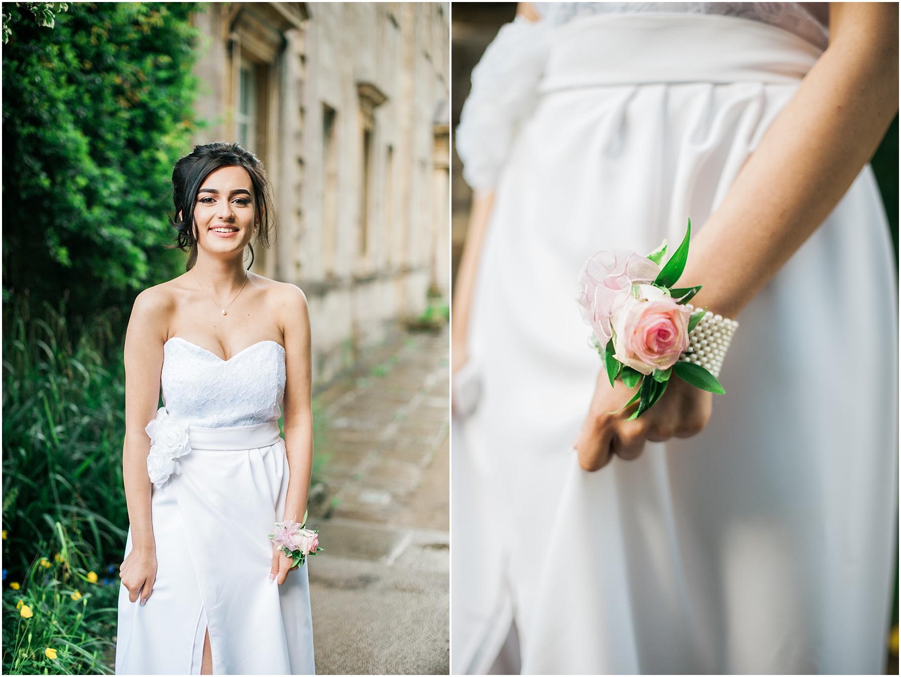 brunette girl wearing a long white dress for her prom
