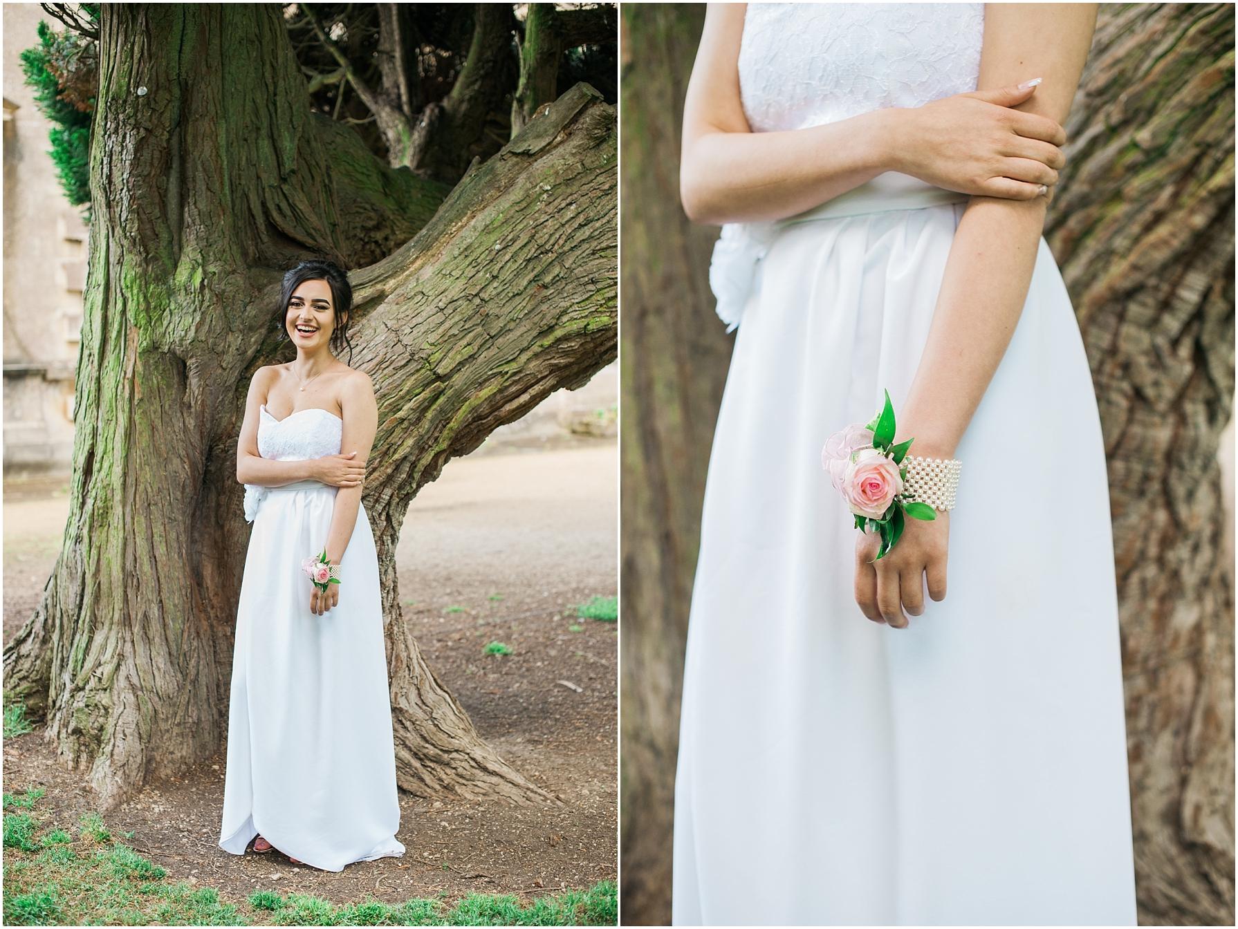 brunette girl wearing along white prom dress