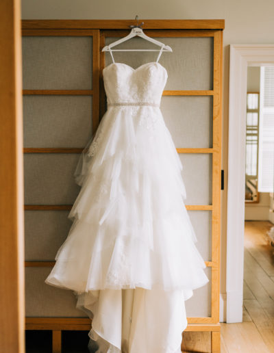 wedding dress hanging in the bridal suite at cowley manor