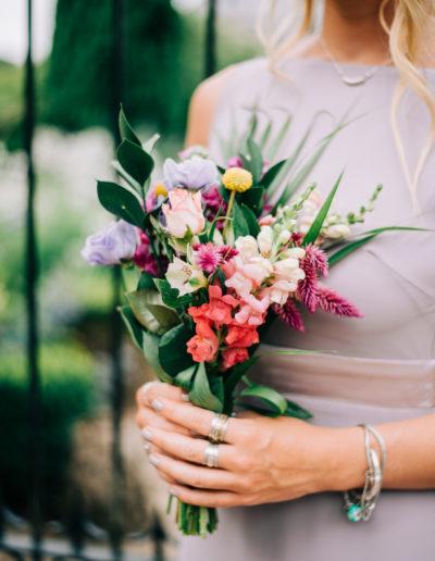 bridesmaid holding wild flower bouquet