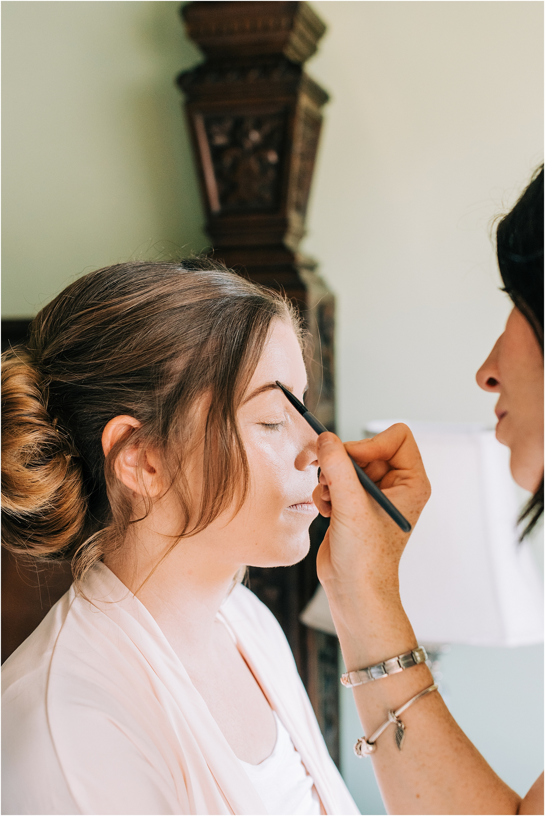 bridesmaid having her makeup done by Katy Pheiffer