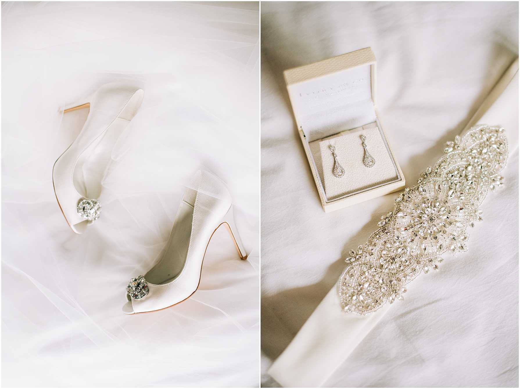 bridal shoes and earrings laying on a white bed