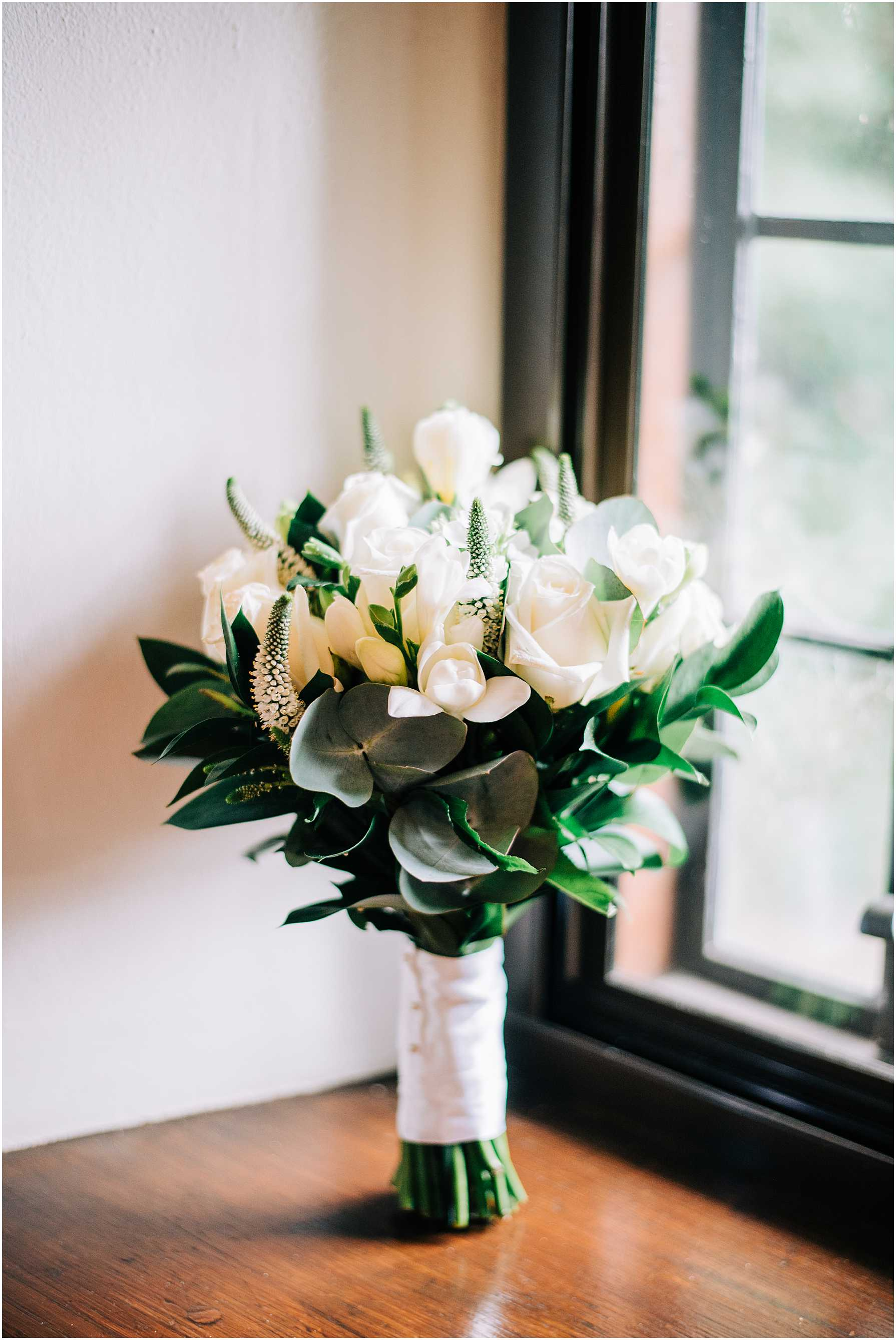 bridal bouquet sitting in window sill