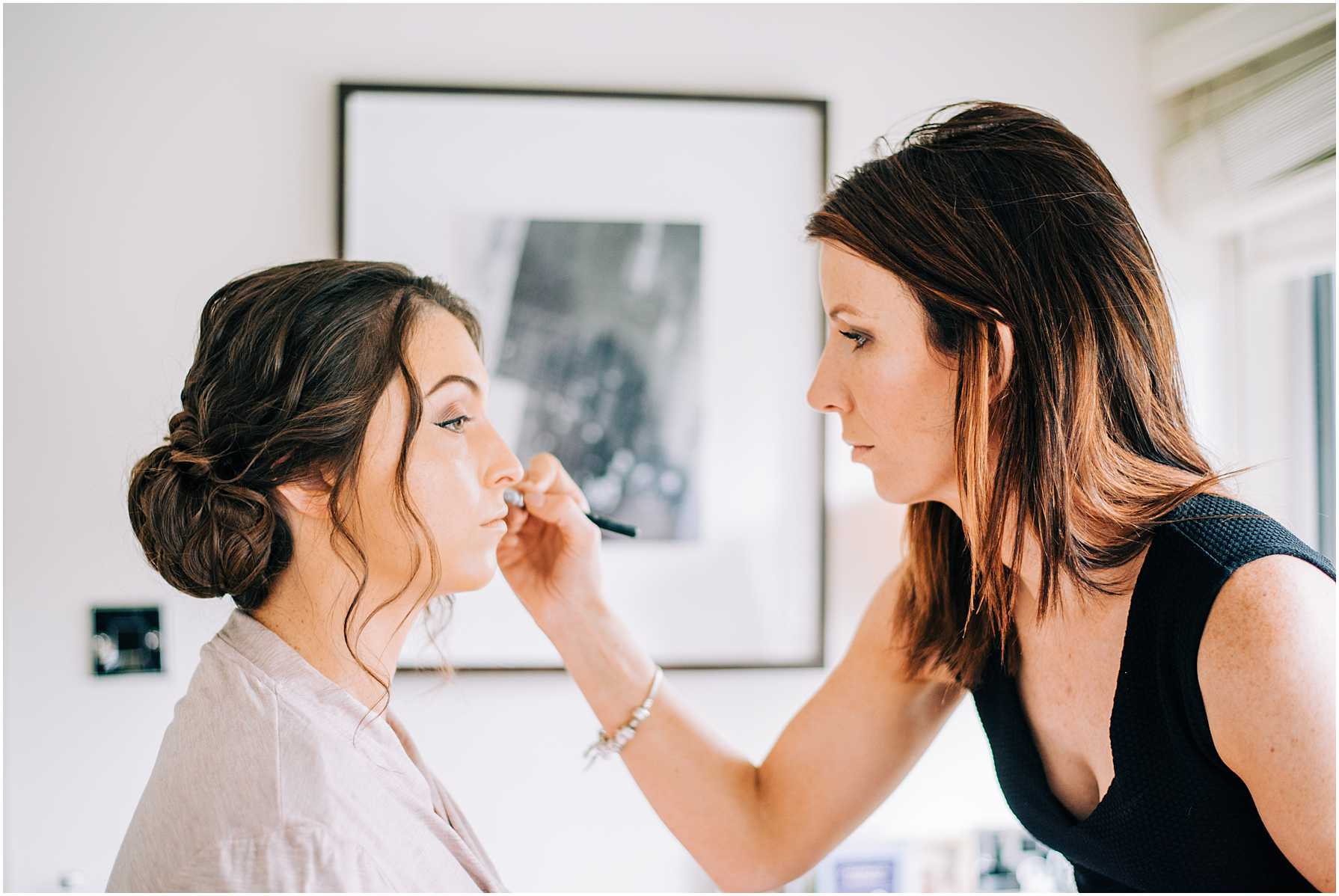 bridesmaids having her makeup done