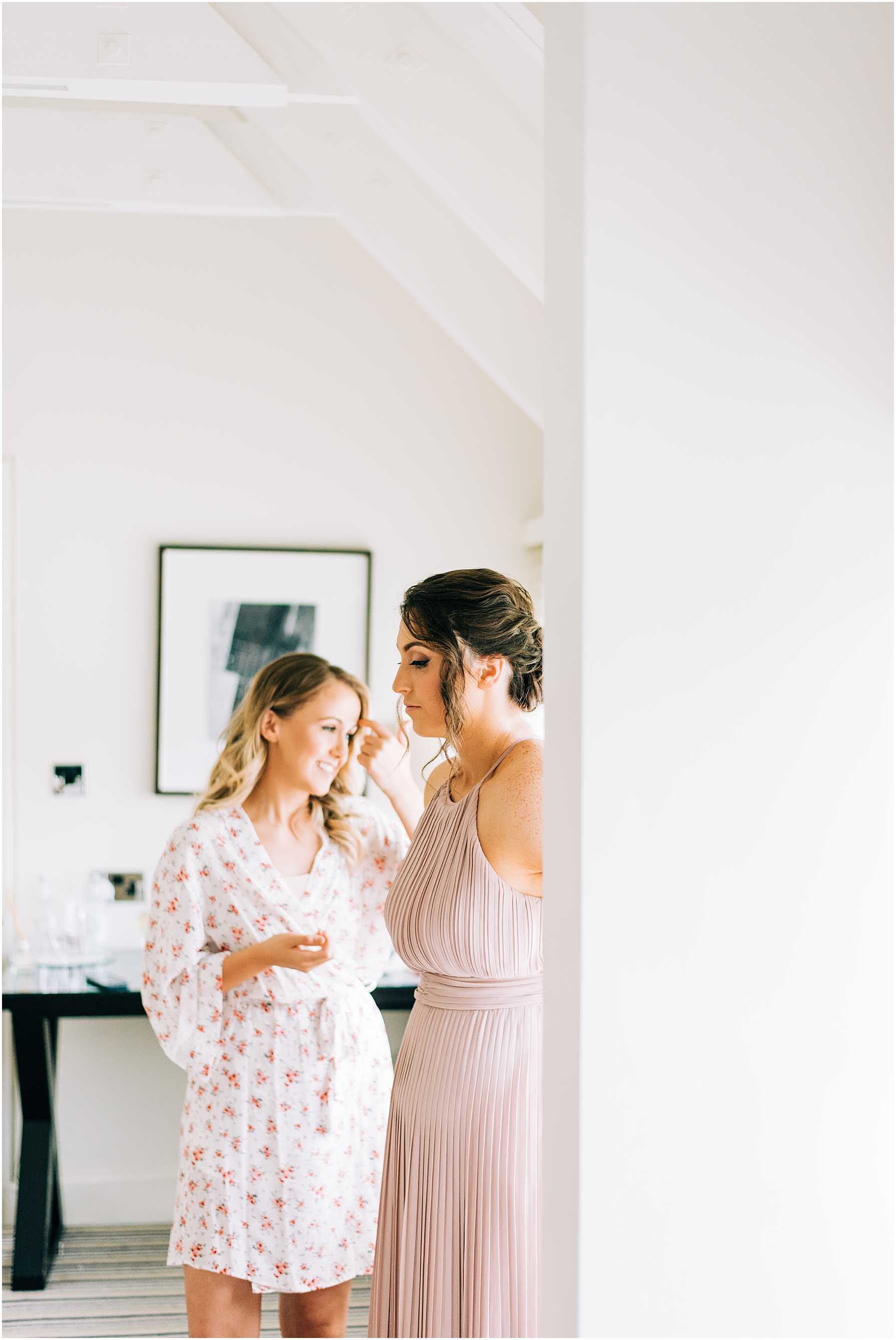 bride and bridesmaid waiting in bridal suite