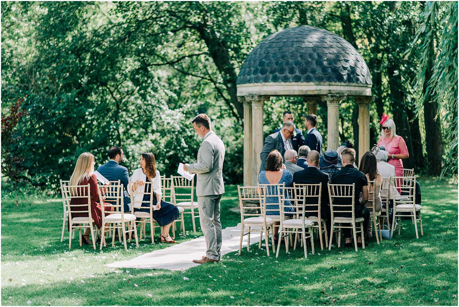 guests gathering for outdoor ceremony at the old swan and minster mill