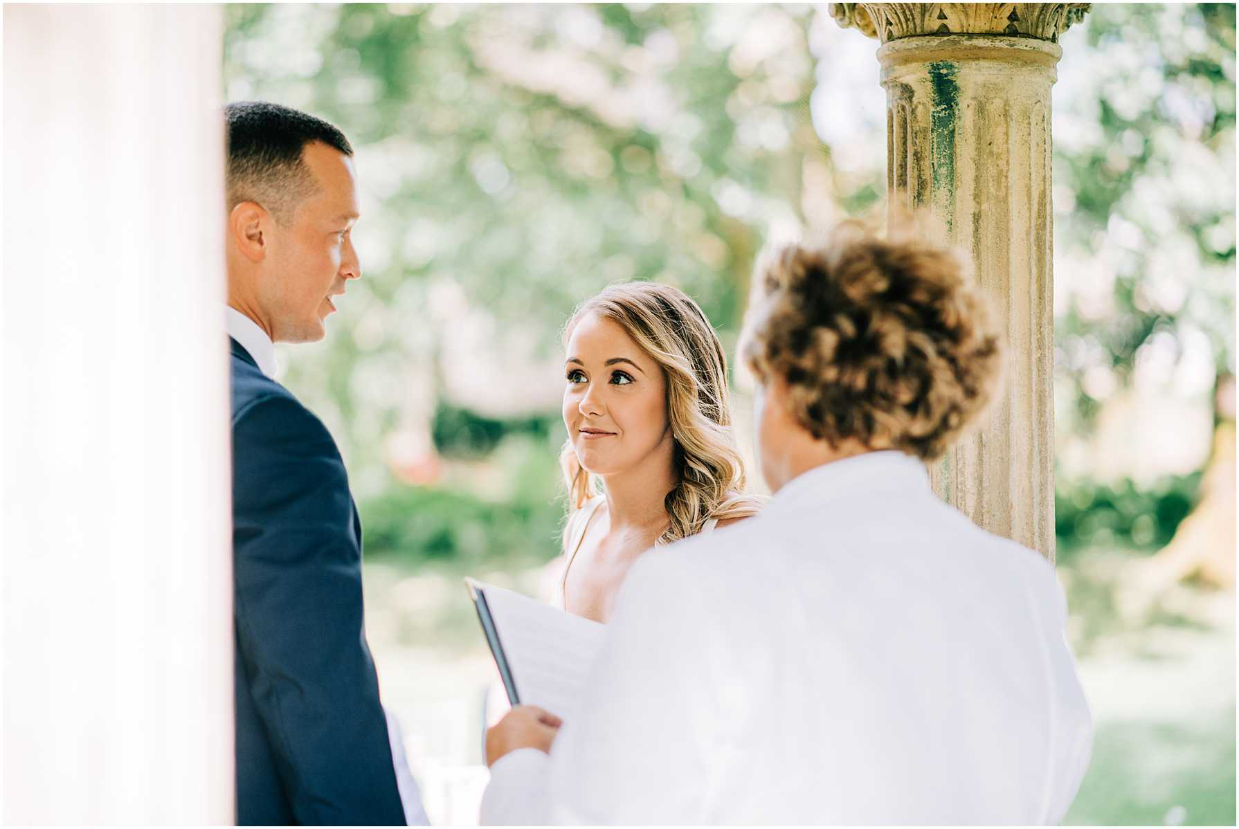 bride looking at her groom during the wedding vows