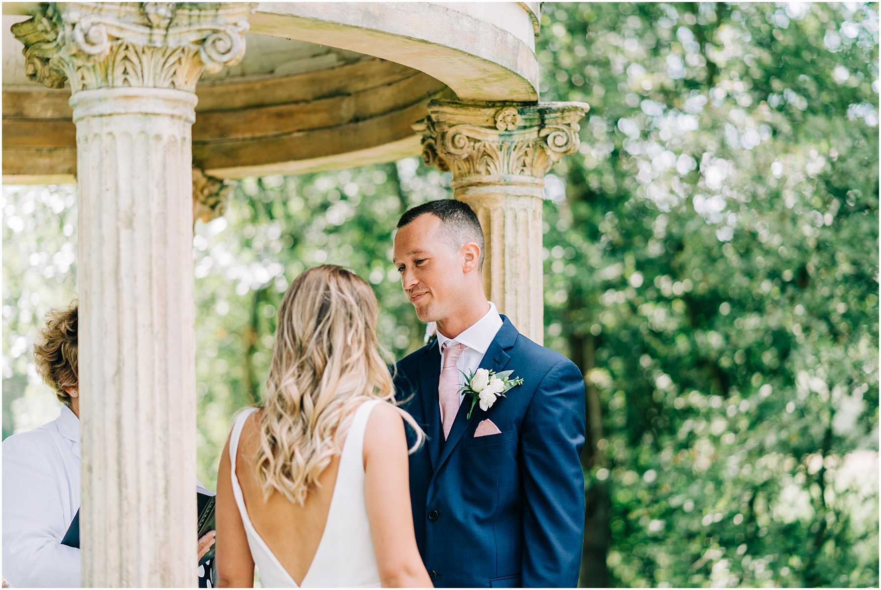 groom looking at his bride during wedding vows