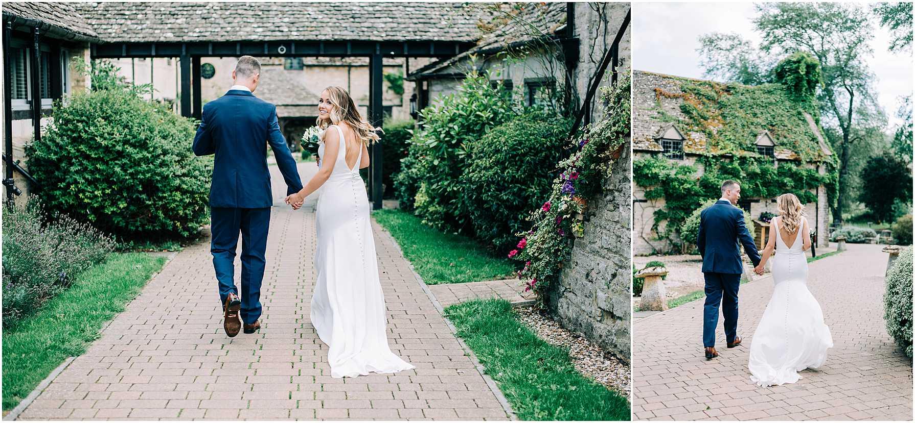 bride looking over her shoulder as her and her groom walk away hand in hand