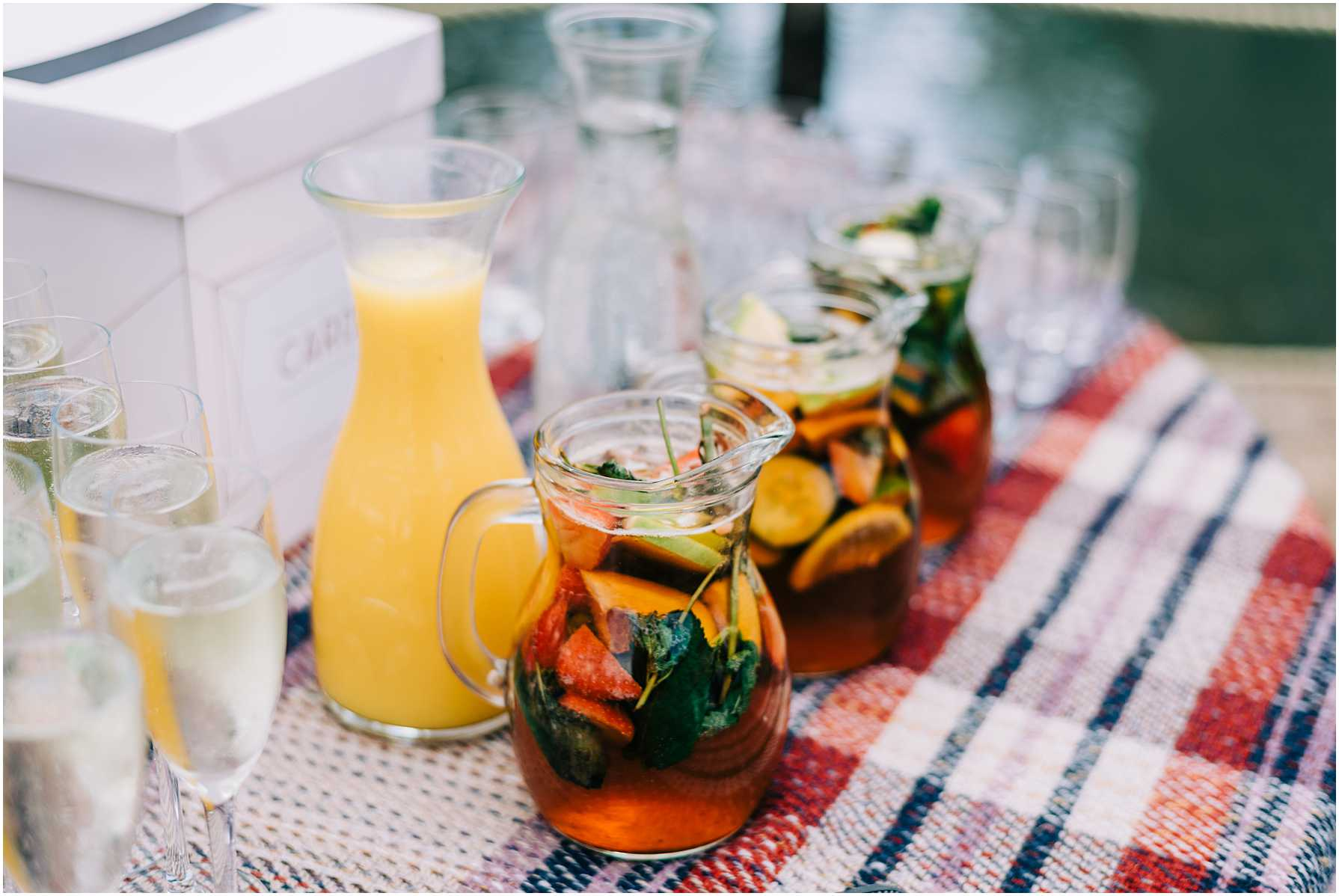 jugs of pimms being served at a wedding
