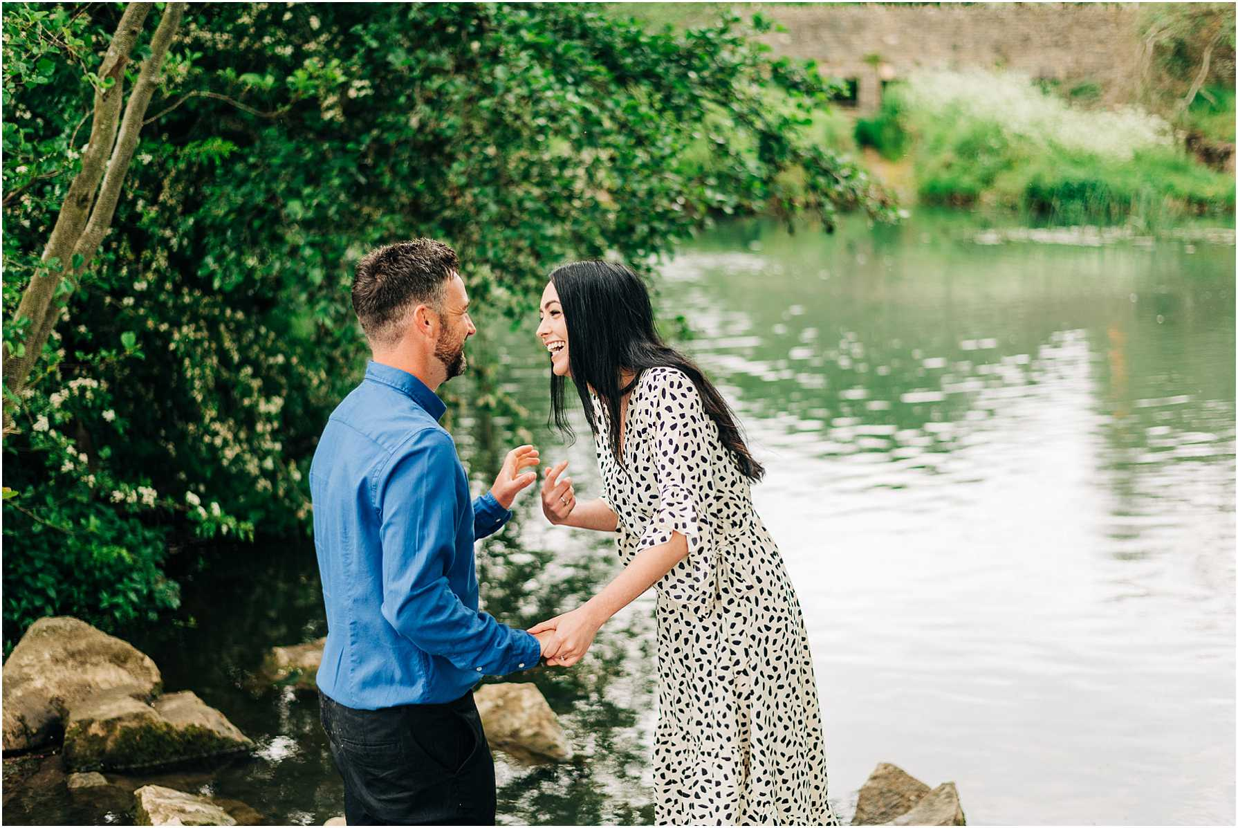 couple standing at the rivers edge at daniel's well