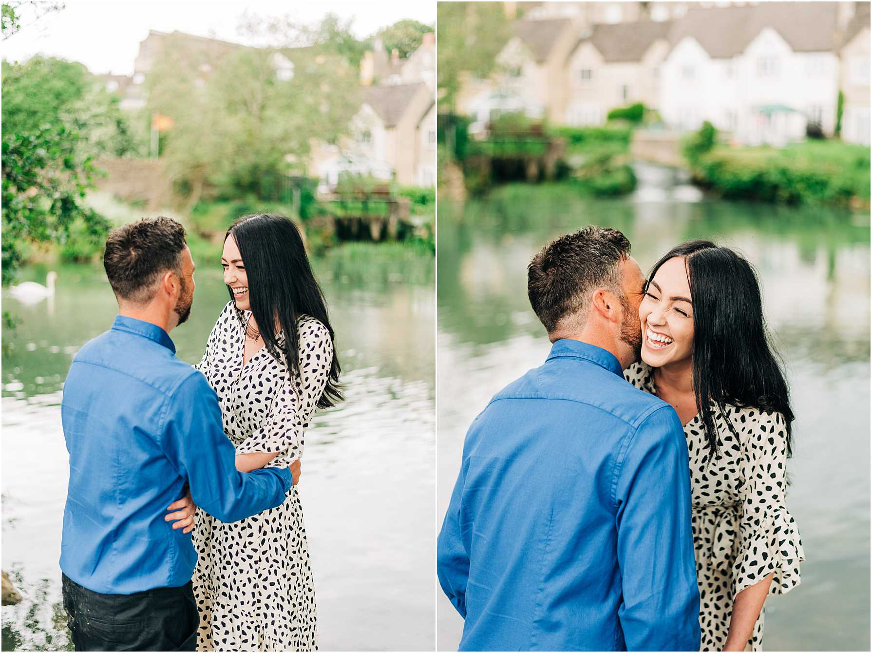 engaged couple laughing together as they stand at rivers edge