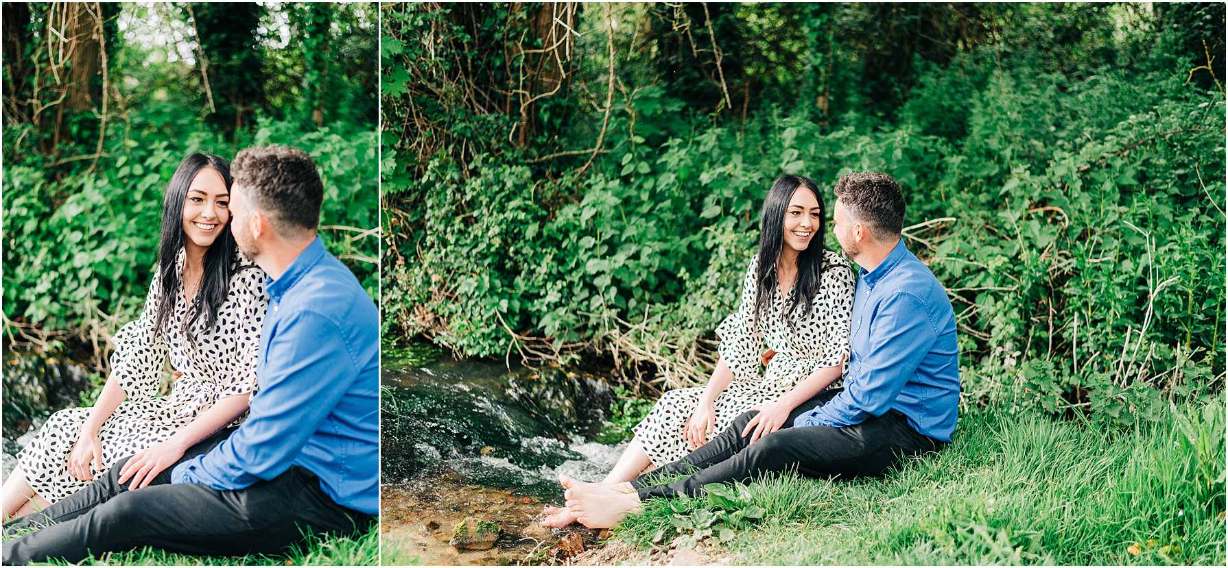 couple sitting next to a running stream with their feet in the water
