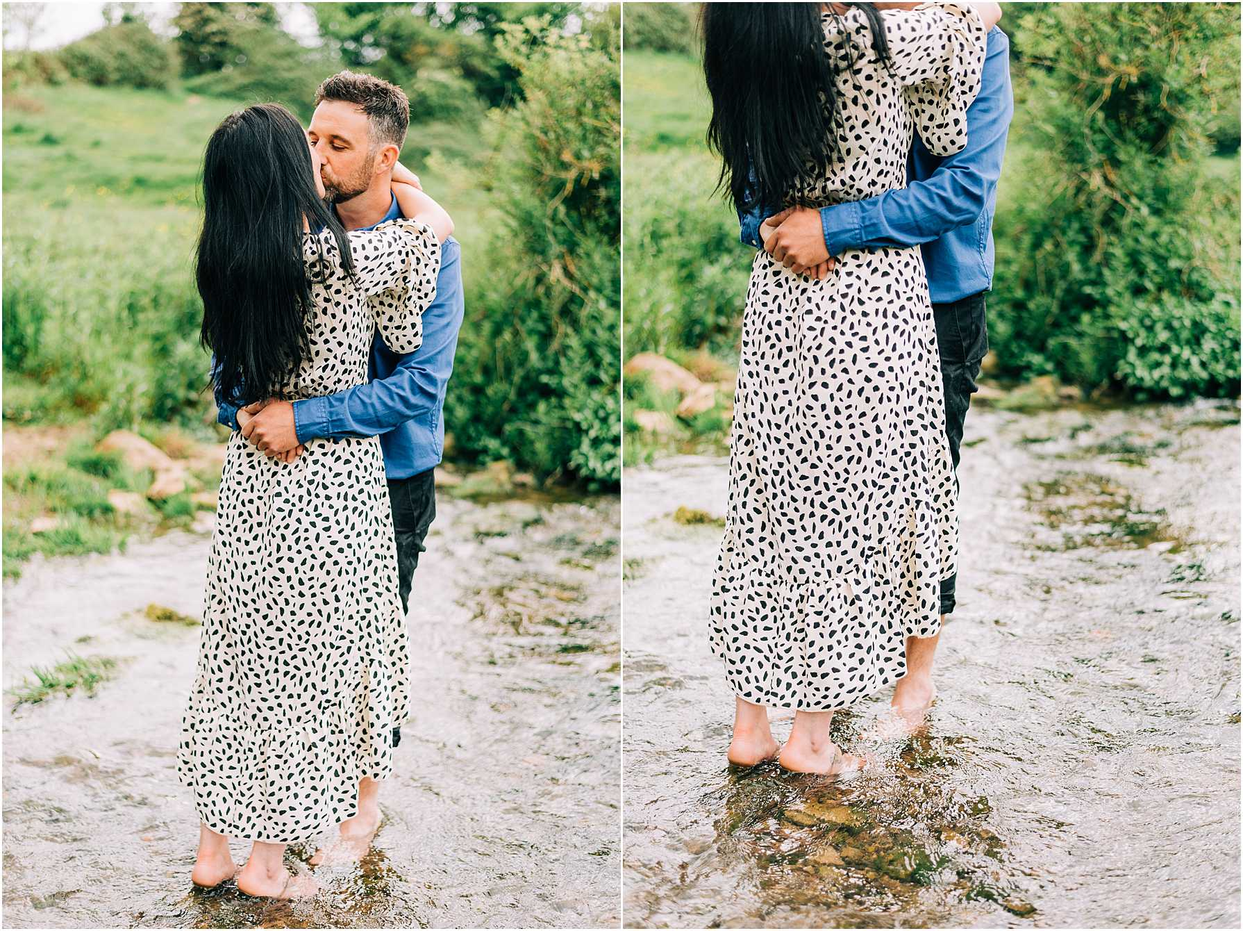 couple standing in a river kissing