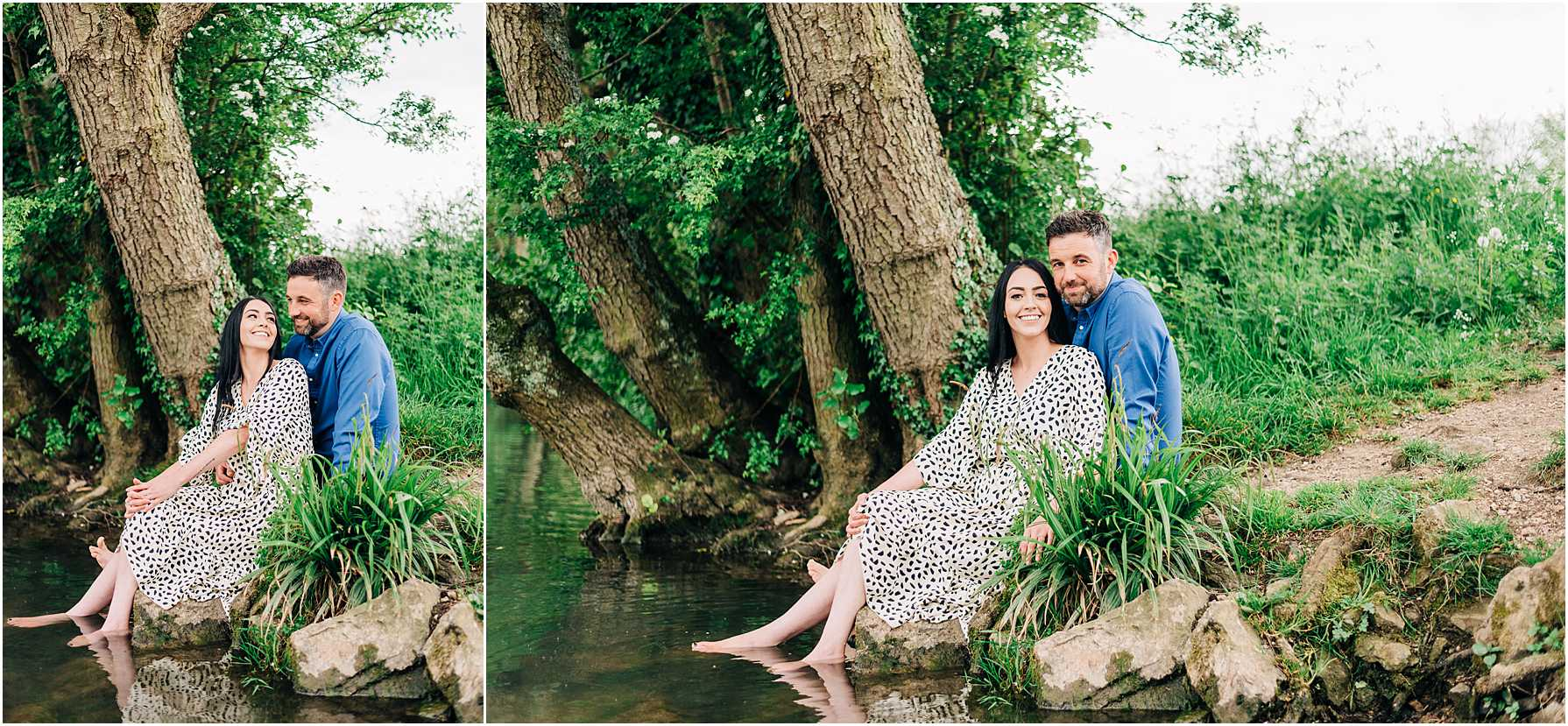 couple sitting on the river edge with their feet in the water