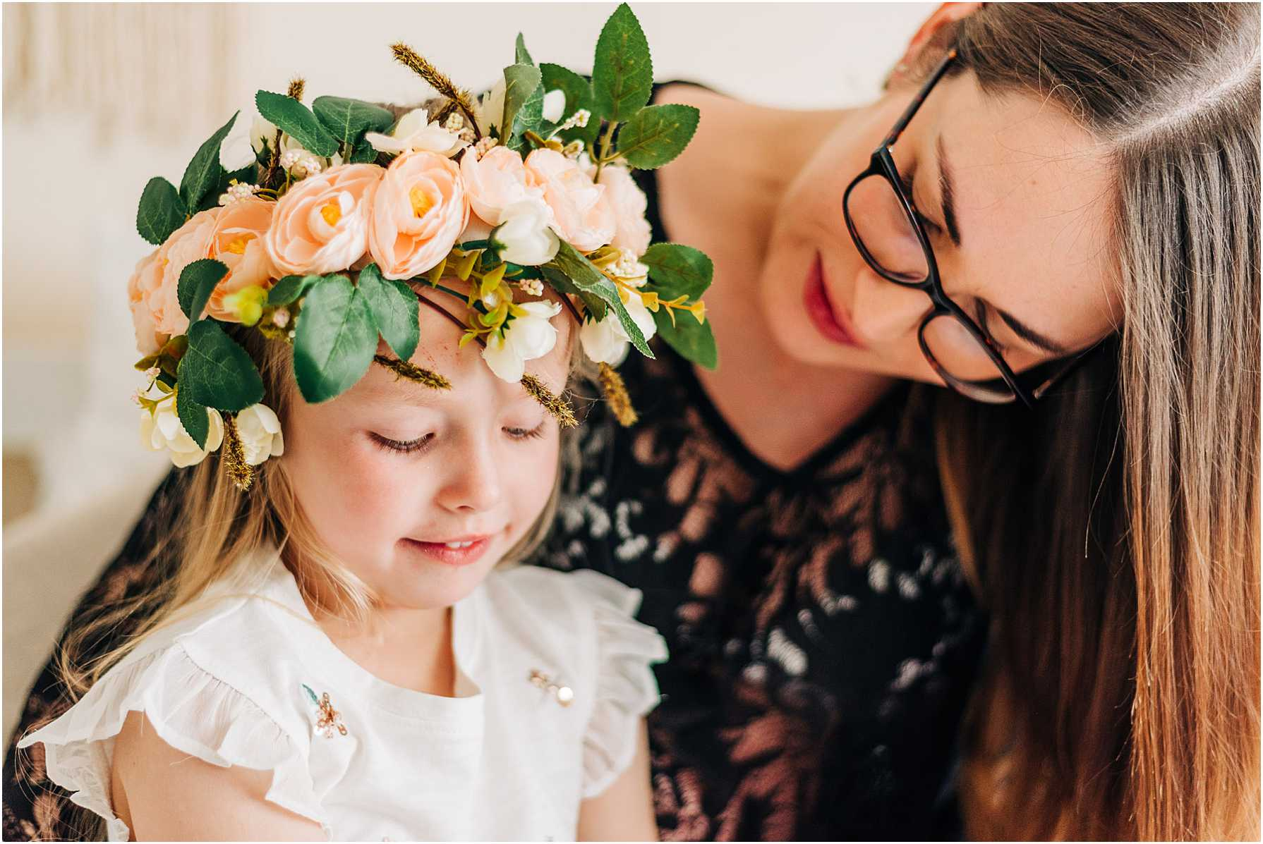 little girl wearing a flower crown during her mothers maternity shoot