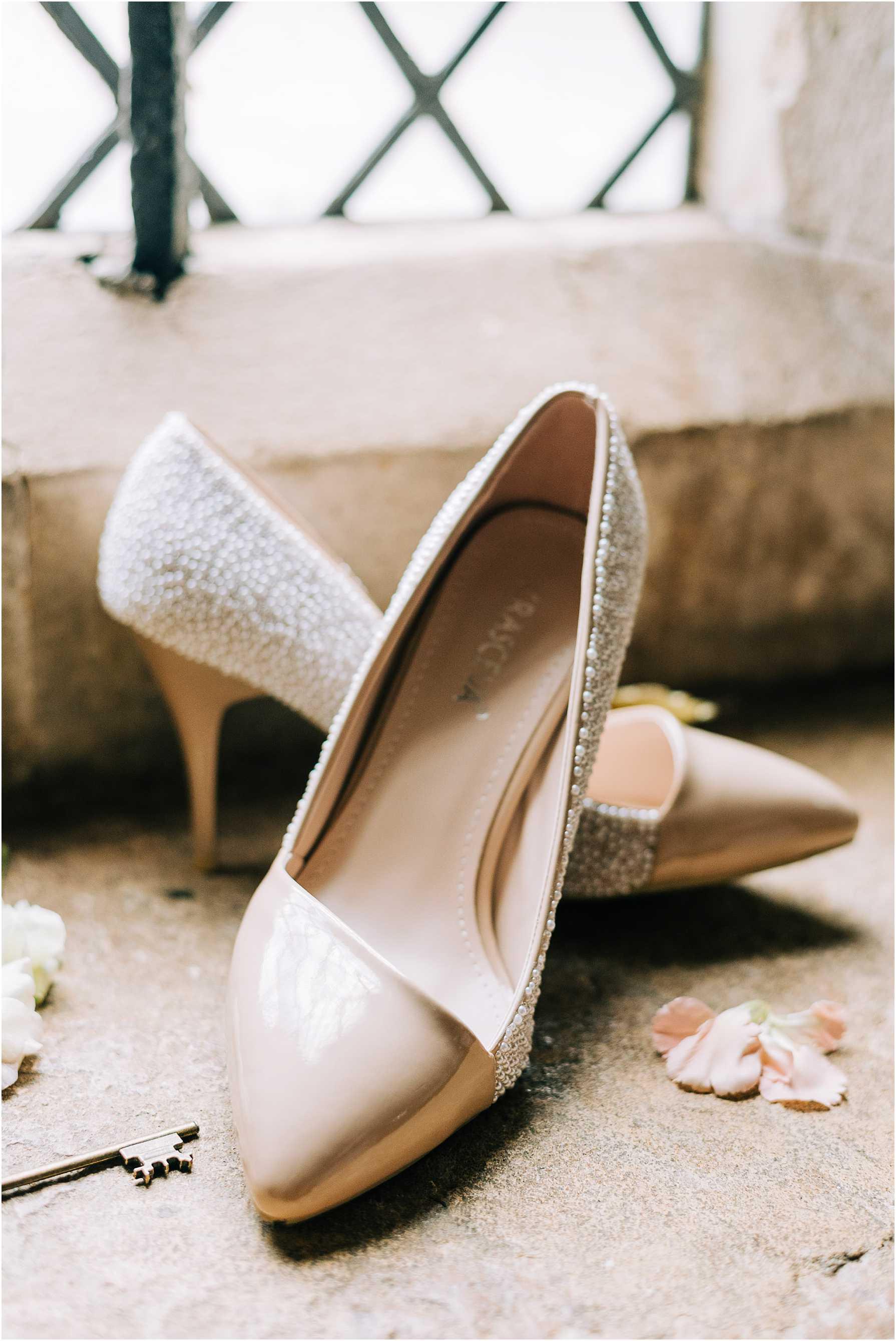handmade diamante wedding shoes on a window sill