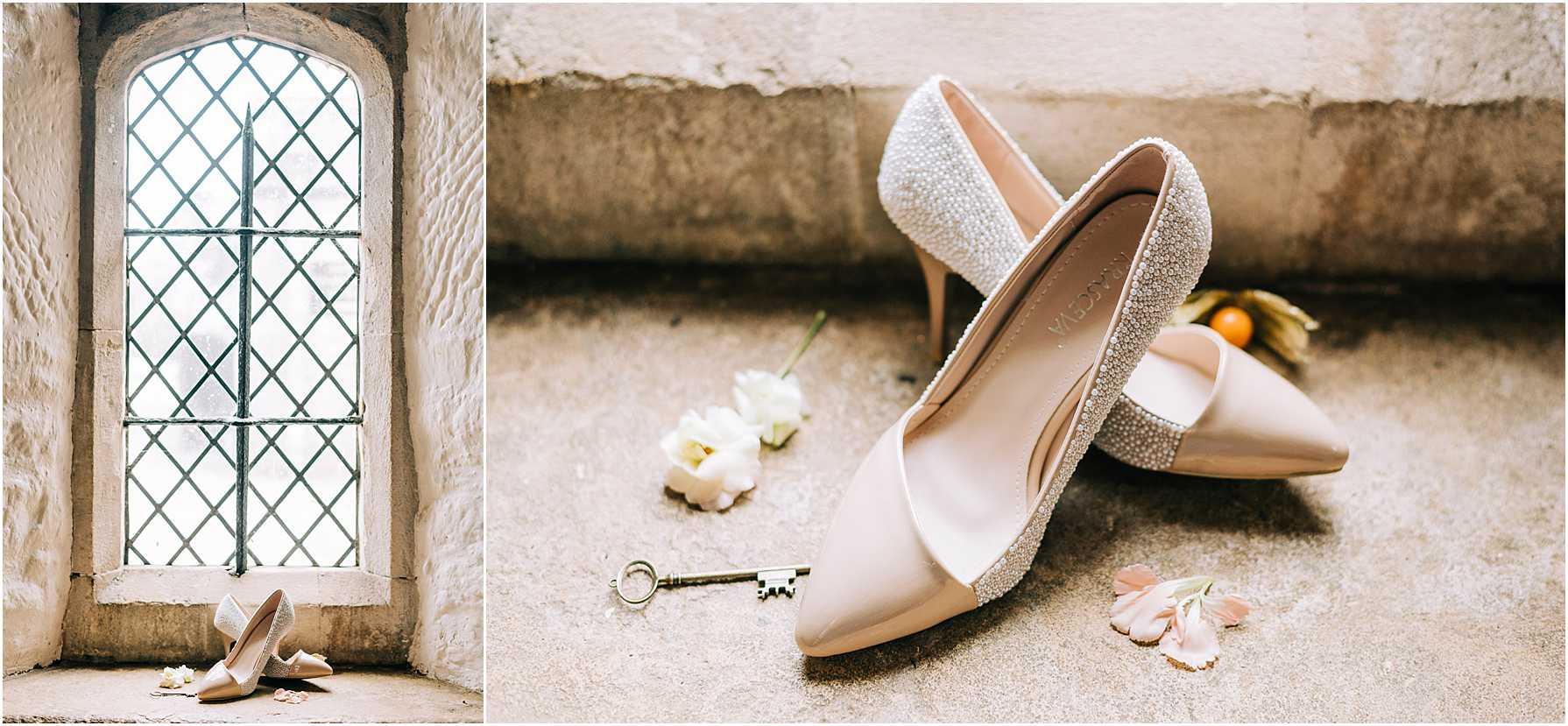 wedding shoes sitting in a brick window sill
