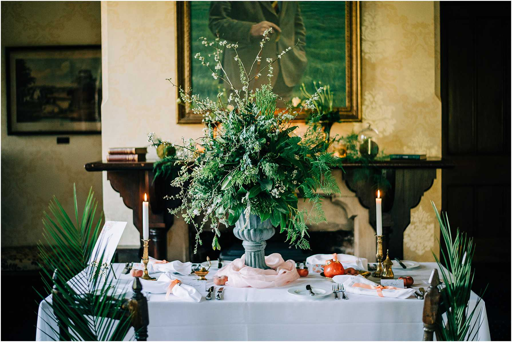 large green foliage centre piece on wedding breakfast table