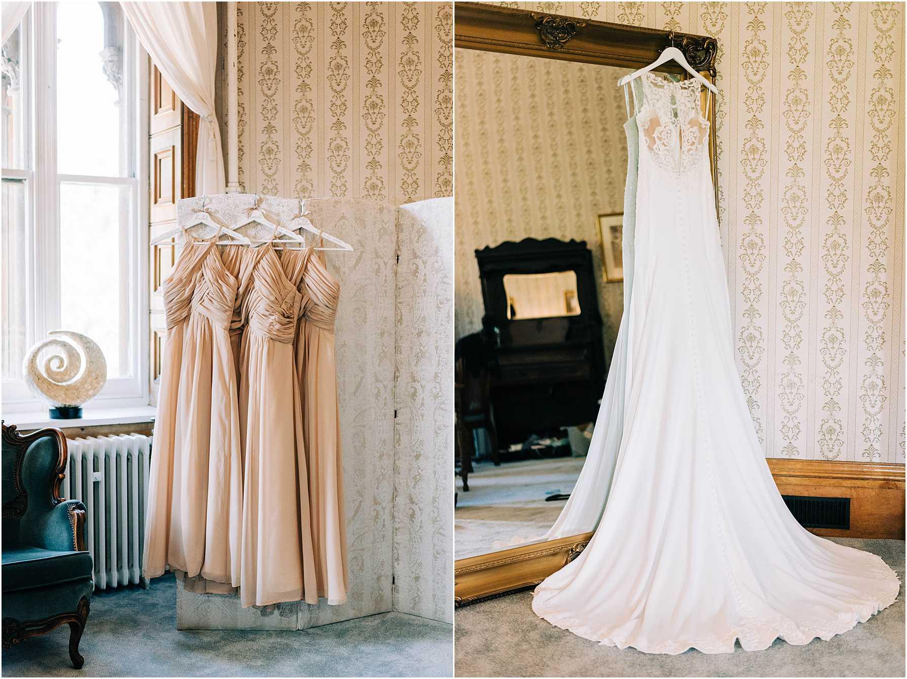 wedding dress hanging on a big mirror