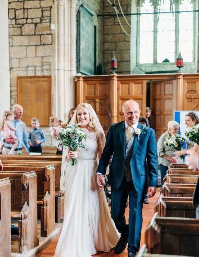 bride walking down the aisle in a church