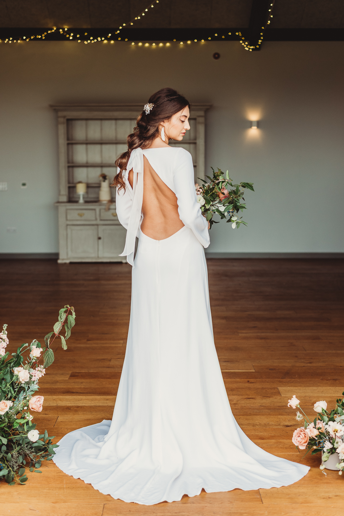 bride wearing a backless silk wedding gown